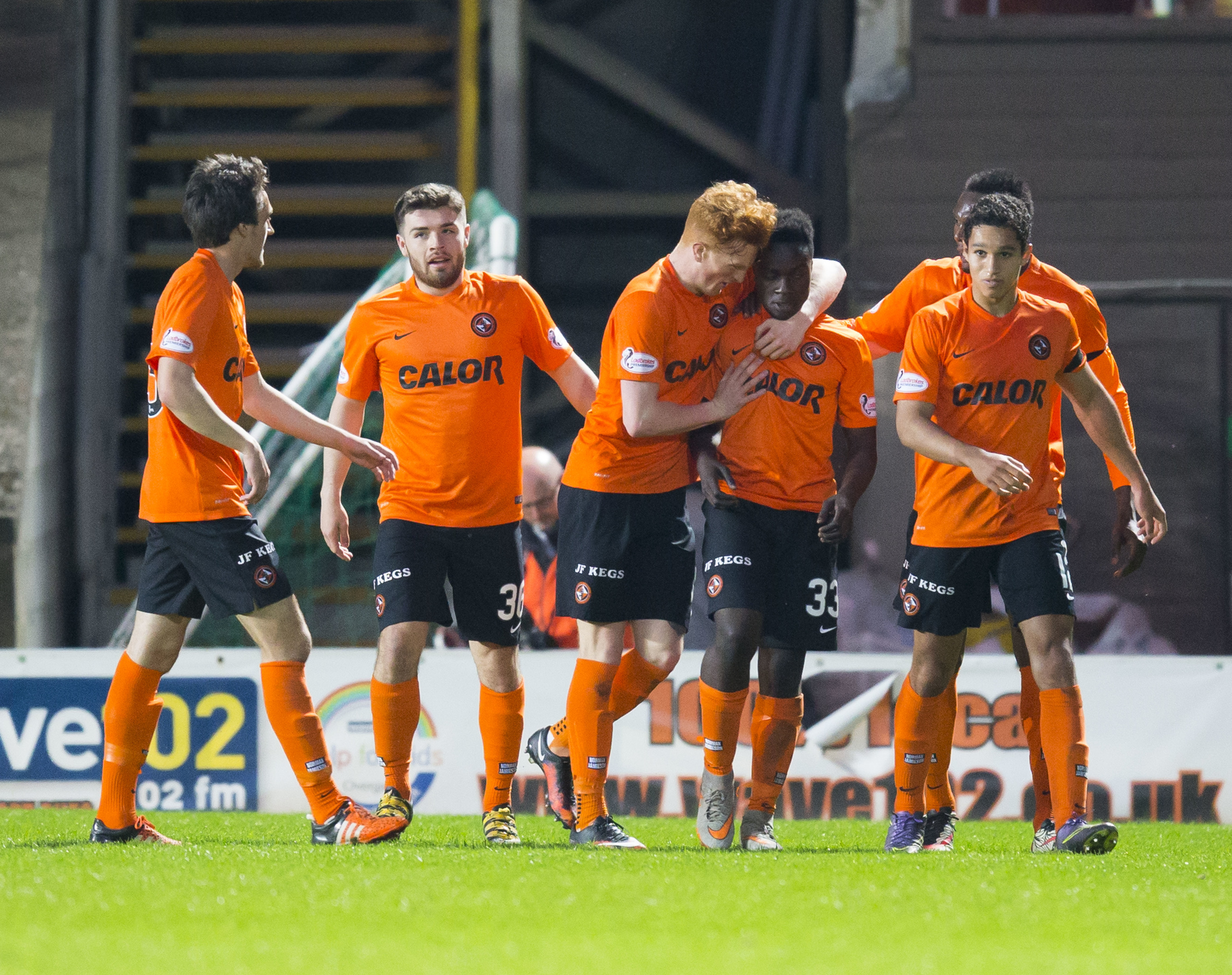Dundee United's Justin Johnson (33) is congratulated by teammates after he scores a late equaliser