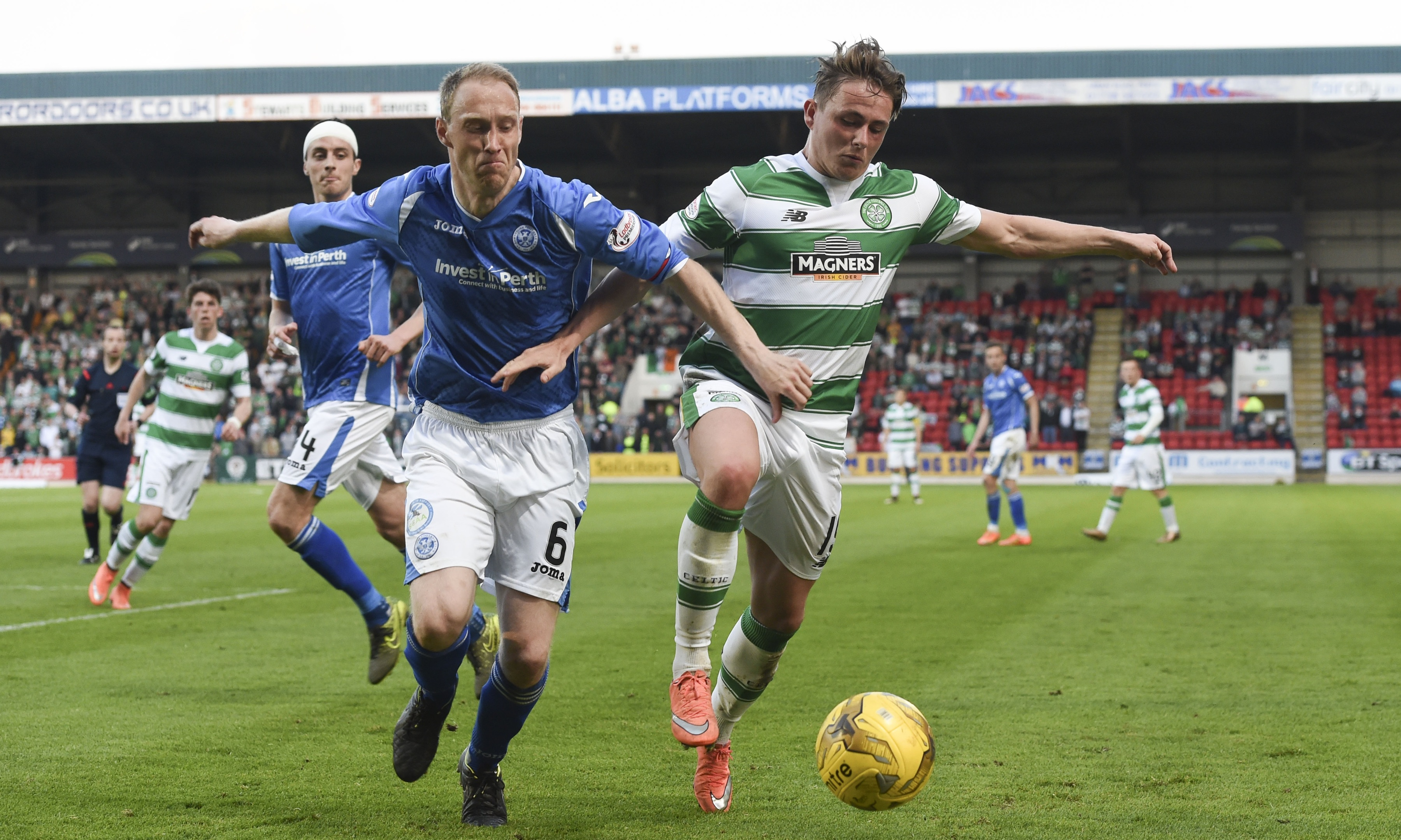 Steven Anderson tussles with Celtic's Scott Allan