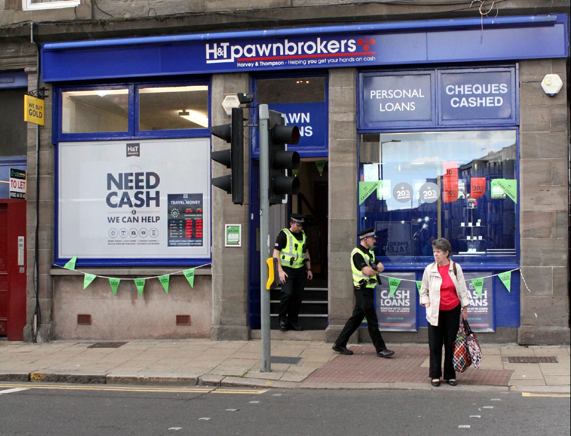 Police at the pawnbrokers.