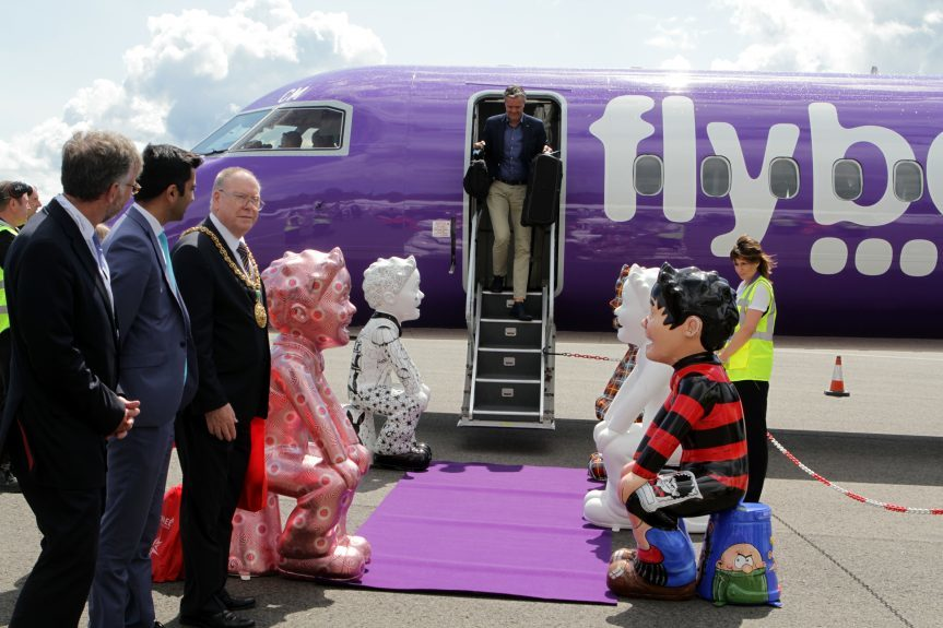 Dignitaries welcome the first person off the plane Wilco Vlaar.