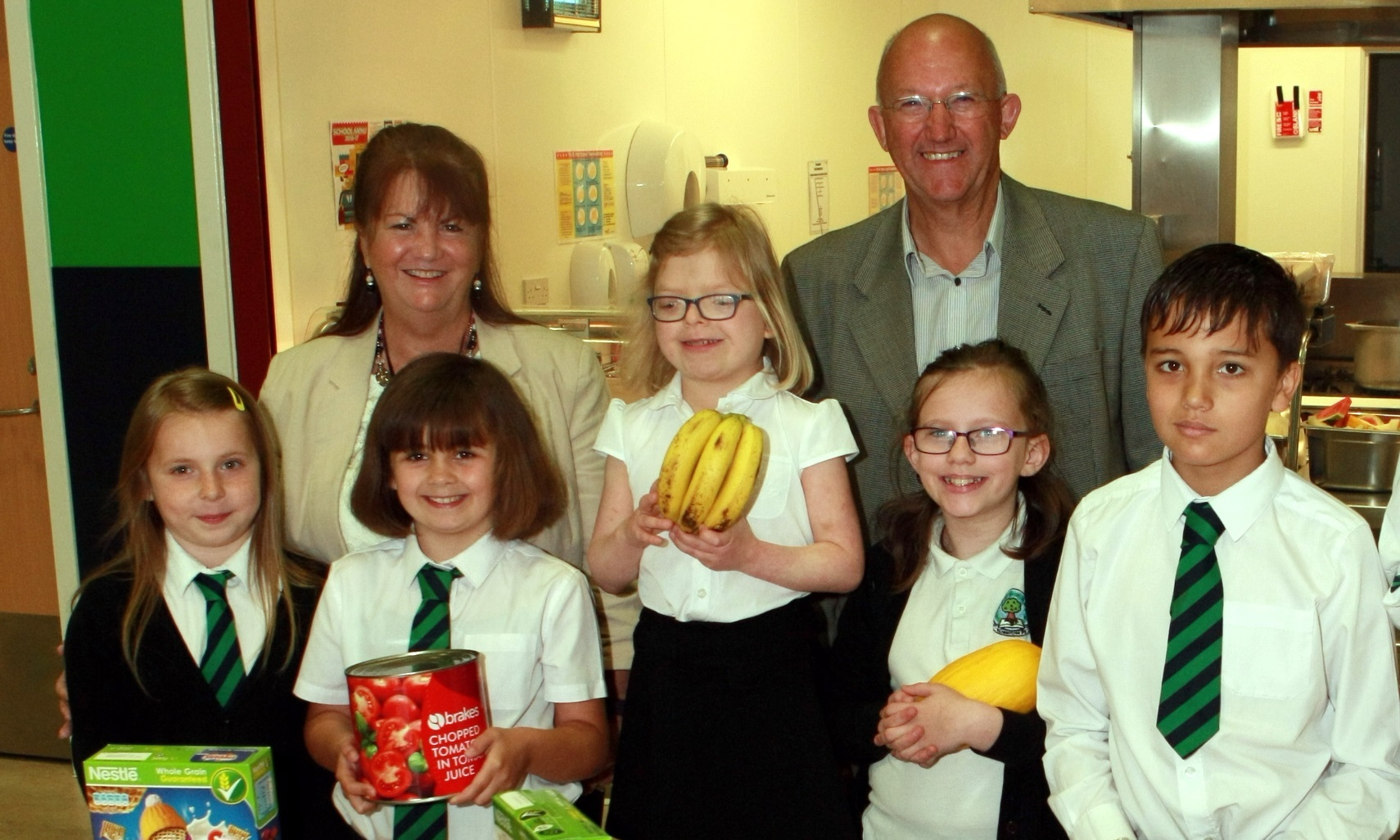At Rowantree Primary are Holly Hawes, Kaya Jamieson, Ava Gibson, Abbie Kennedy and Michael Wilson. At the back is head teacher Emily O'Neill and Dundee Fun & Food co-ordinator David Dorward.