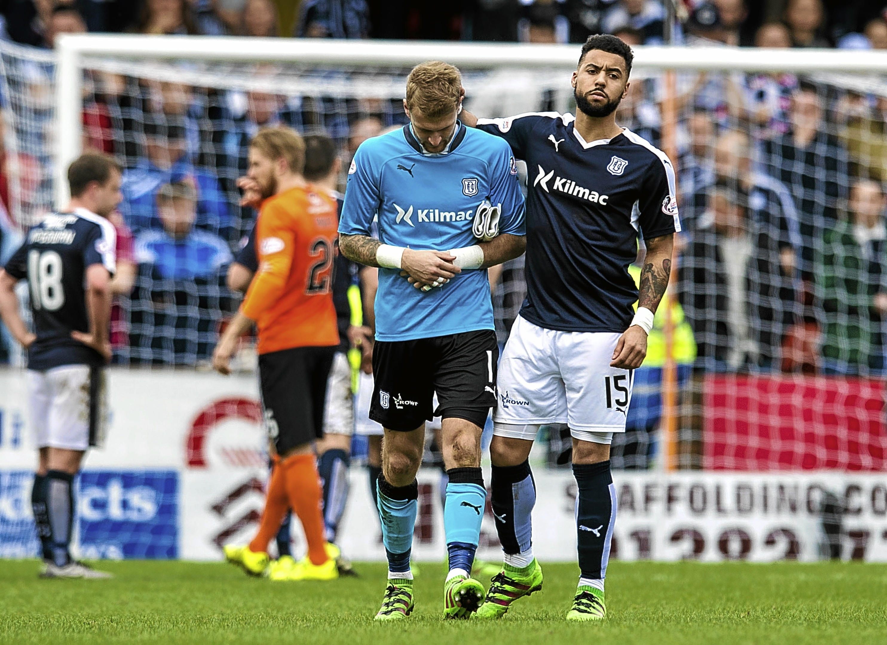 Kane Hemmings tries to console Scott Bain after the Dundee stopper is shown a straight red card after bringing down Dundee United's Billy Mckay in the box at Tannadice in March.