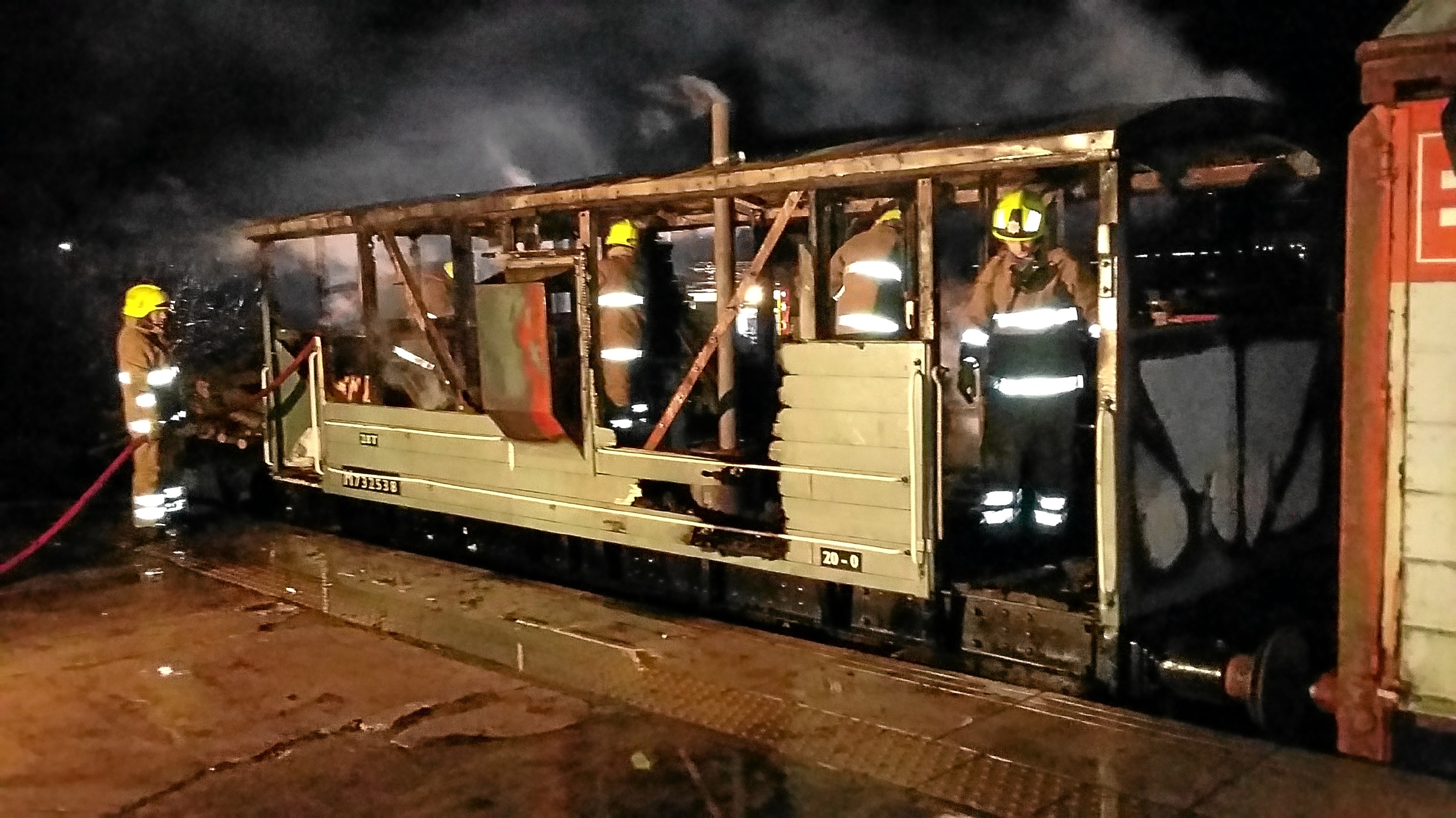 Firefighters tackling a blaze on a Caledonian Railway brakevan. An investigation into the fire is ongoing, with the culprit still not found.