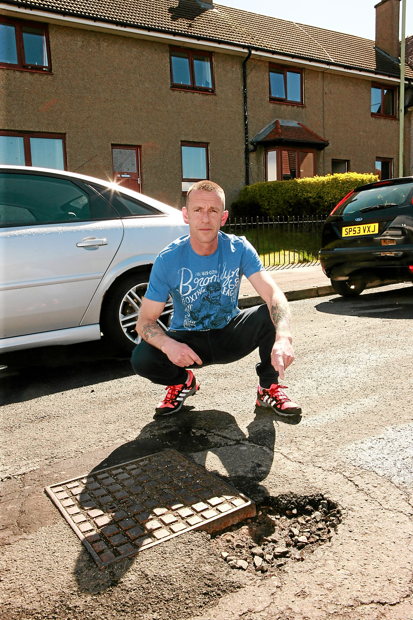 Scott Bruce, 48, has described the potholes on Beauly Crescent in Kirkton as a shambles