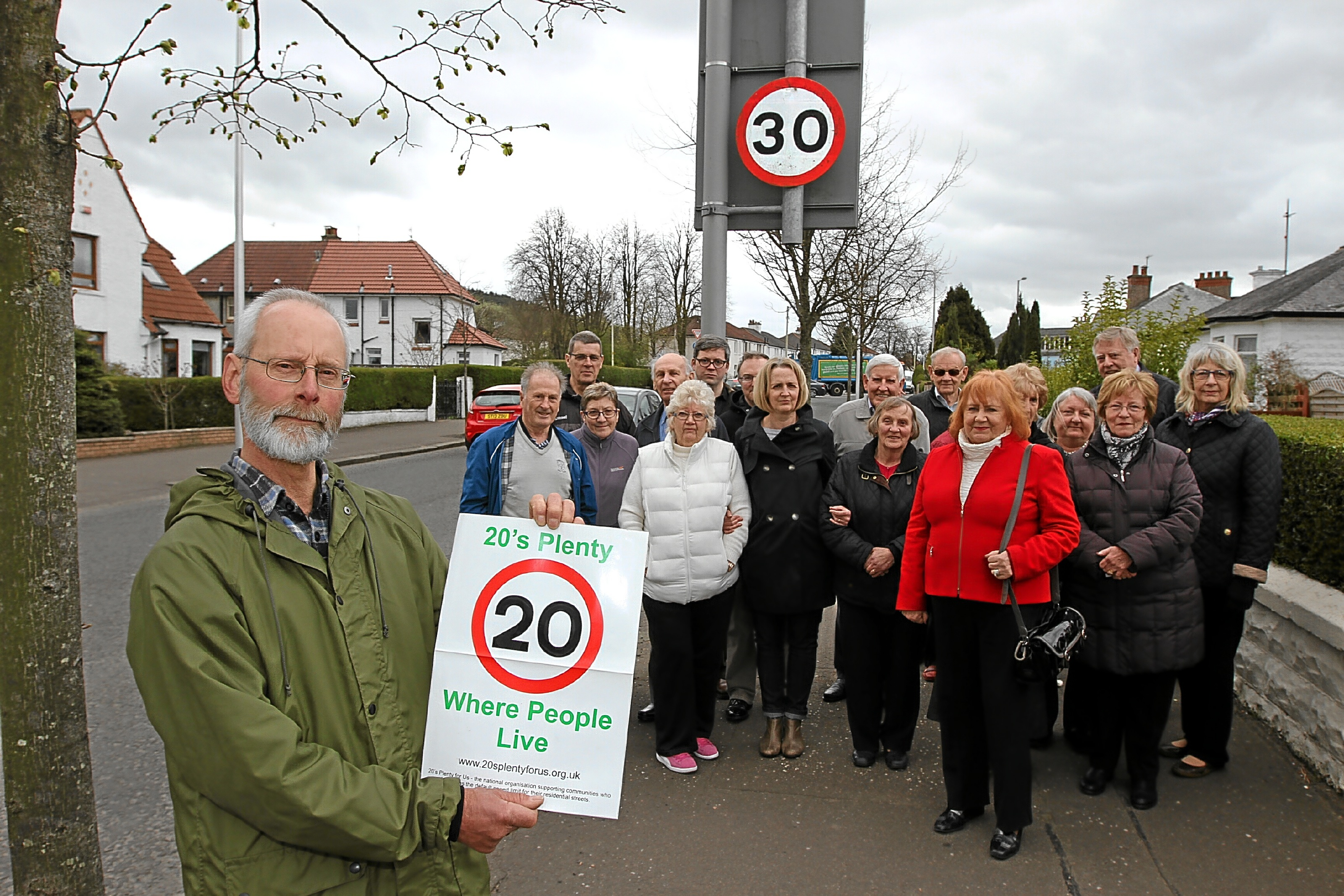 Derek Paton — pictured along with other residents — wants a permanent 20mph speed limit on Johnston Avenue in Brantwood.