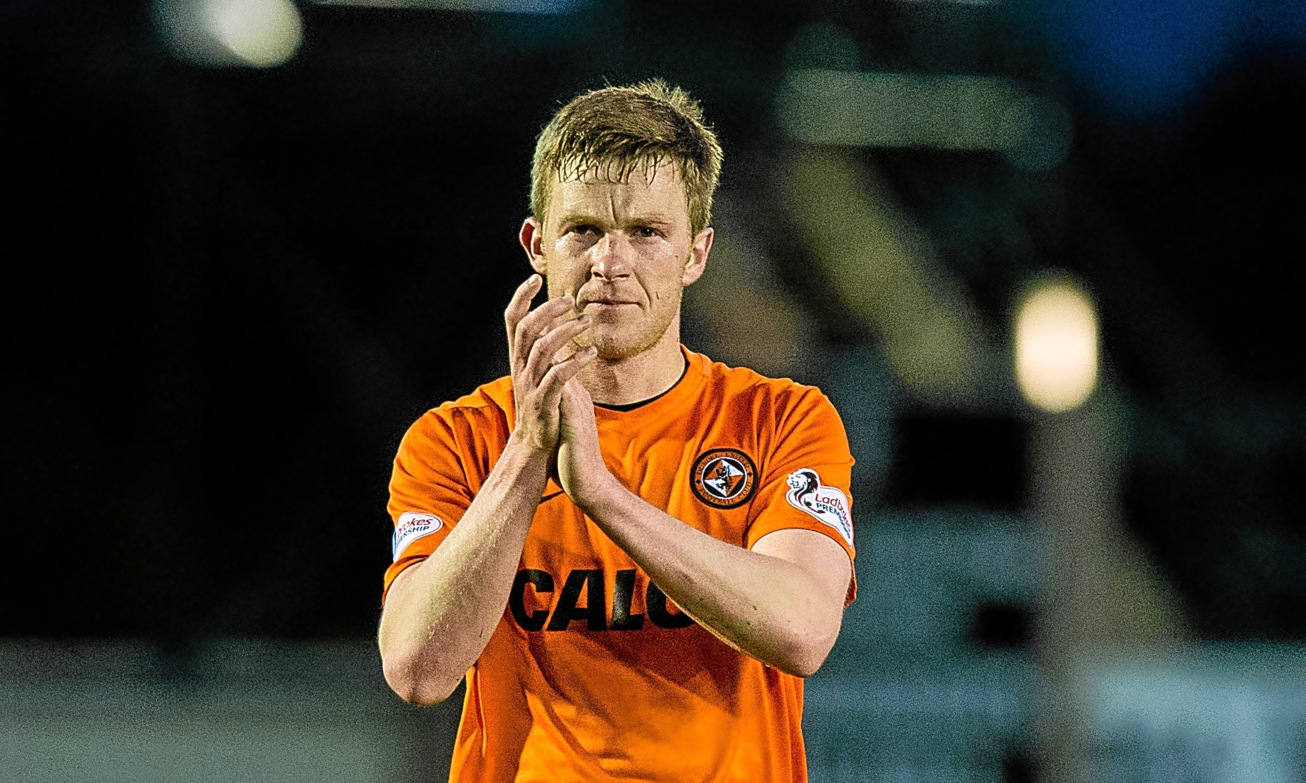 Paul Dixon applauds the travelling support after the 3-2 win over Inverness Caley Thistle.