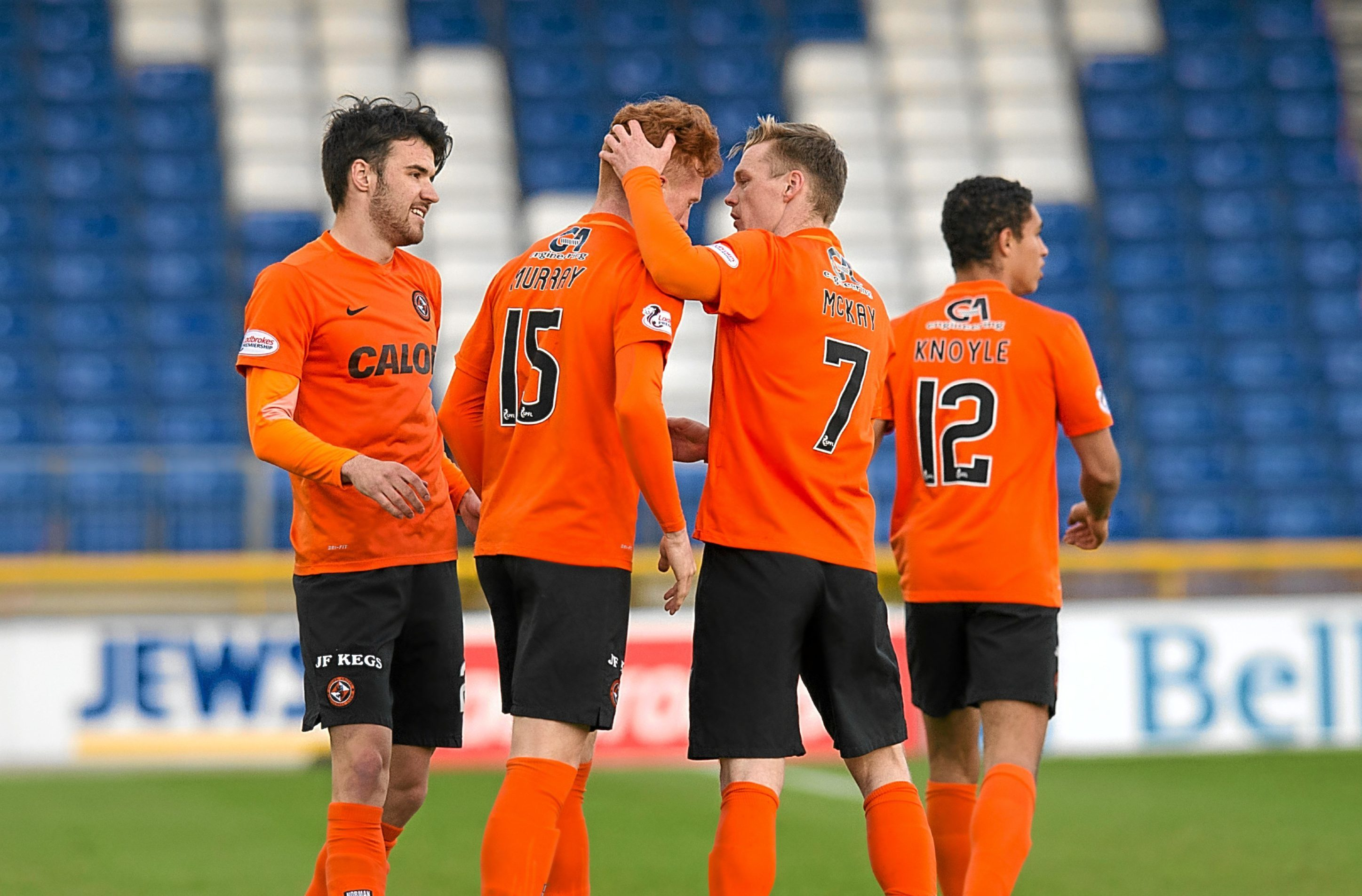 Simon Murray is congratulated by his team-mates after opening the scoring against Inverness during the Tangerines' surprise 3-2 Premiership win on Friday evening.