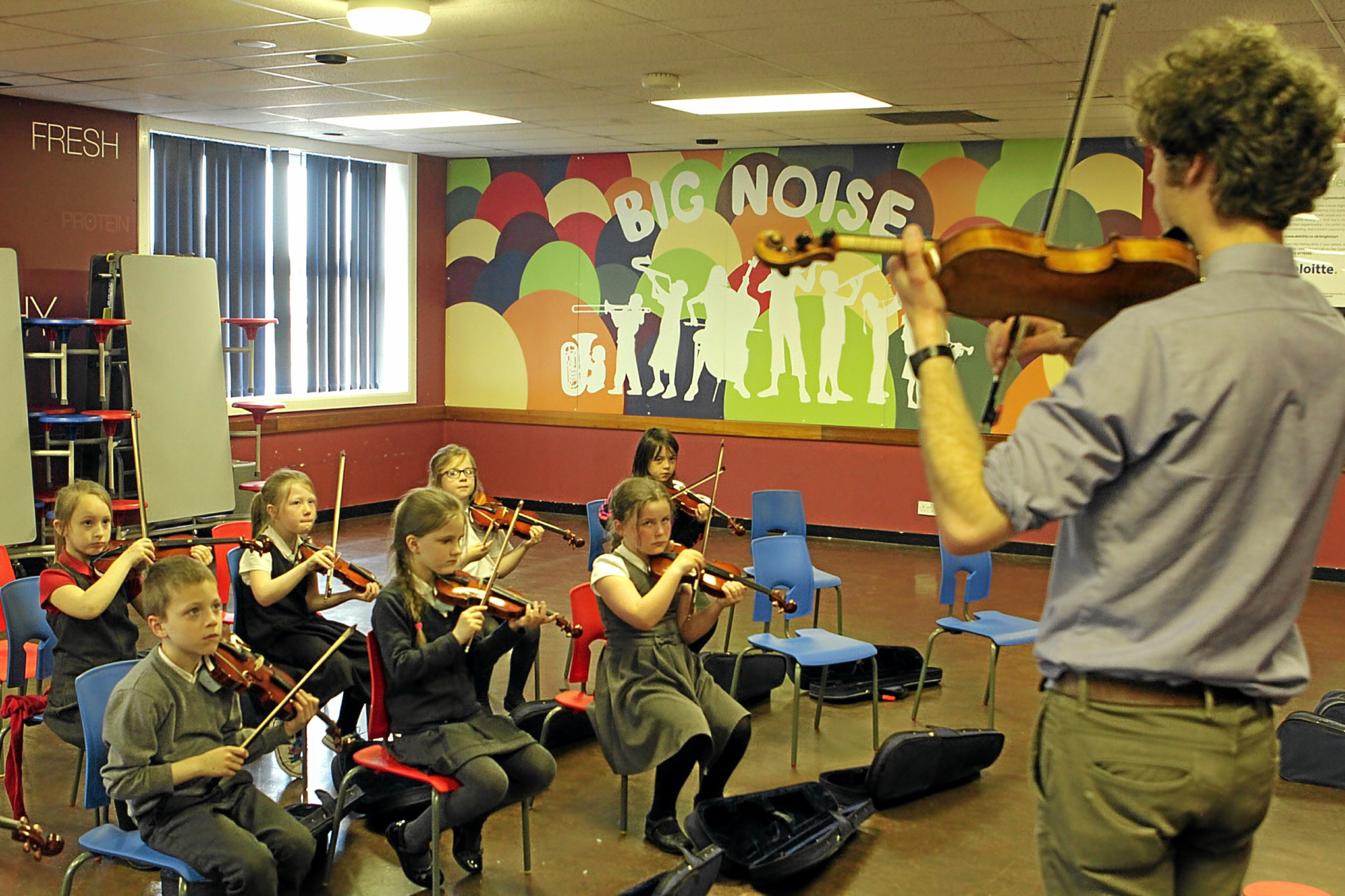 Gordon Robbie Evening Telegraph Big Noise Torry at Torry Academy Aberdeen  violins with Frances  Moore Collyer