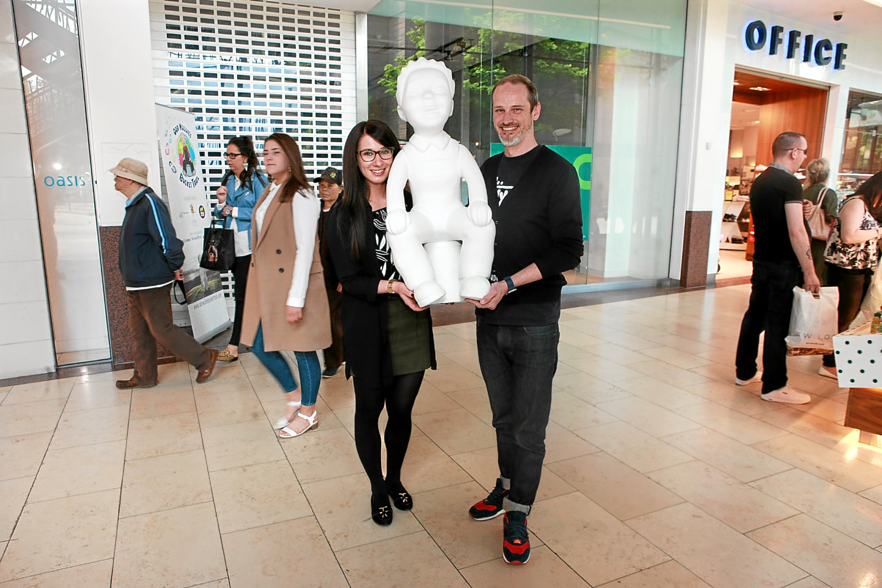 Overgate retail marketing assistant Metta Ramsay and Neil Cooney at the unit with one of the Wullies.