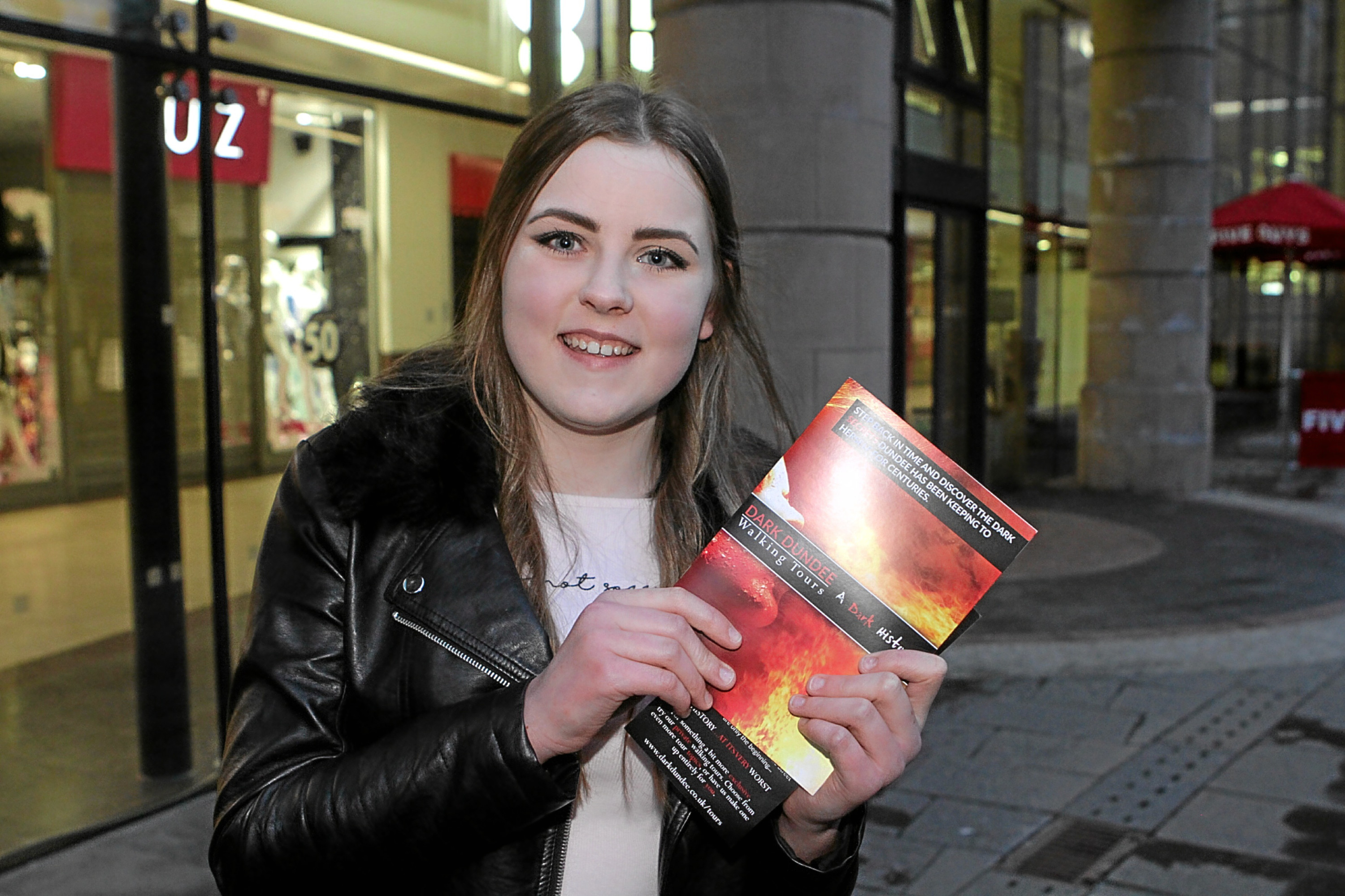 Tour-goer Bethany Morrison with her programme.