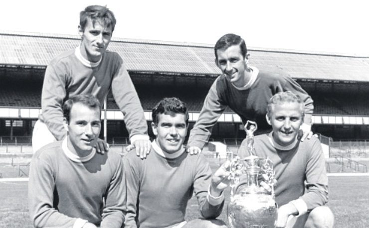 Four of the Everton goalscorers are in this photo. Clockwise from top left — Derek Temple, Roy Vernon, Alex Young, Alex Scott and Dennis Stevens. They are posing with the First Division Championship trophy which the team won in season 62-63.