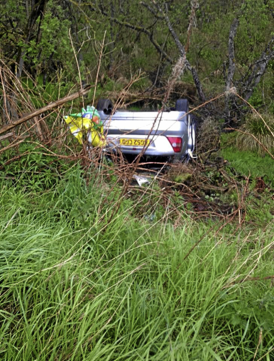 A driver and a friend had a lucky escape after the vehicle they were in rolled over three times down a bank.
