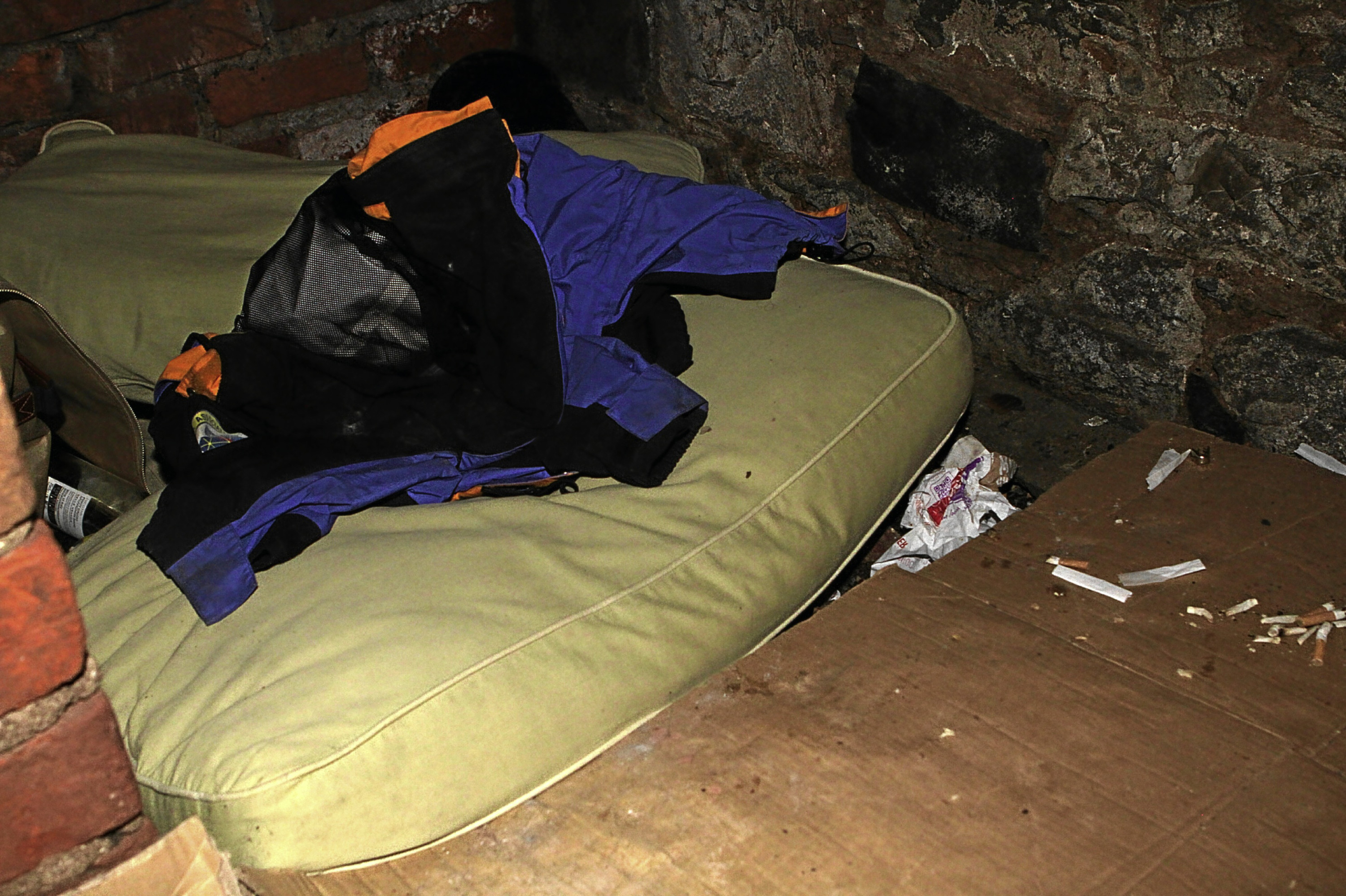 What appears to be a makeshift bed has been set up within the block of flats.