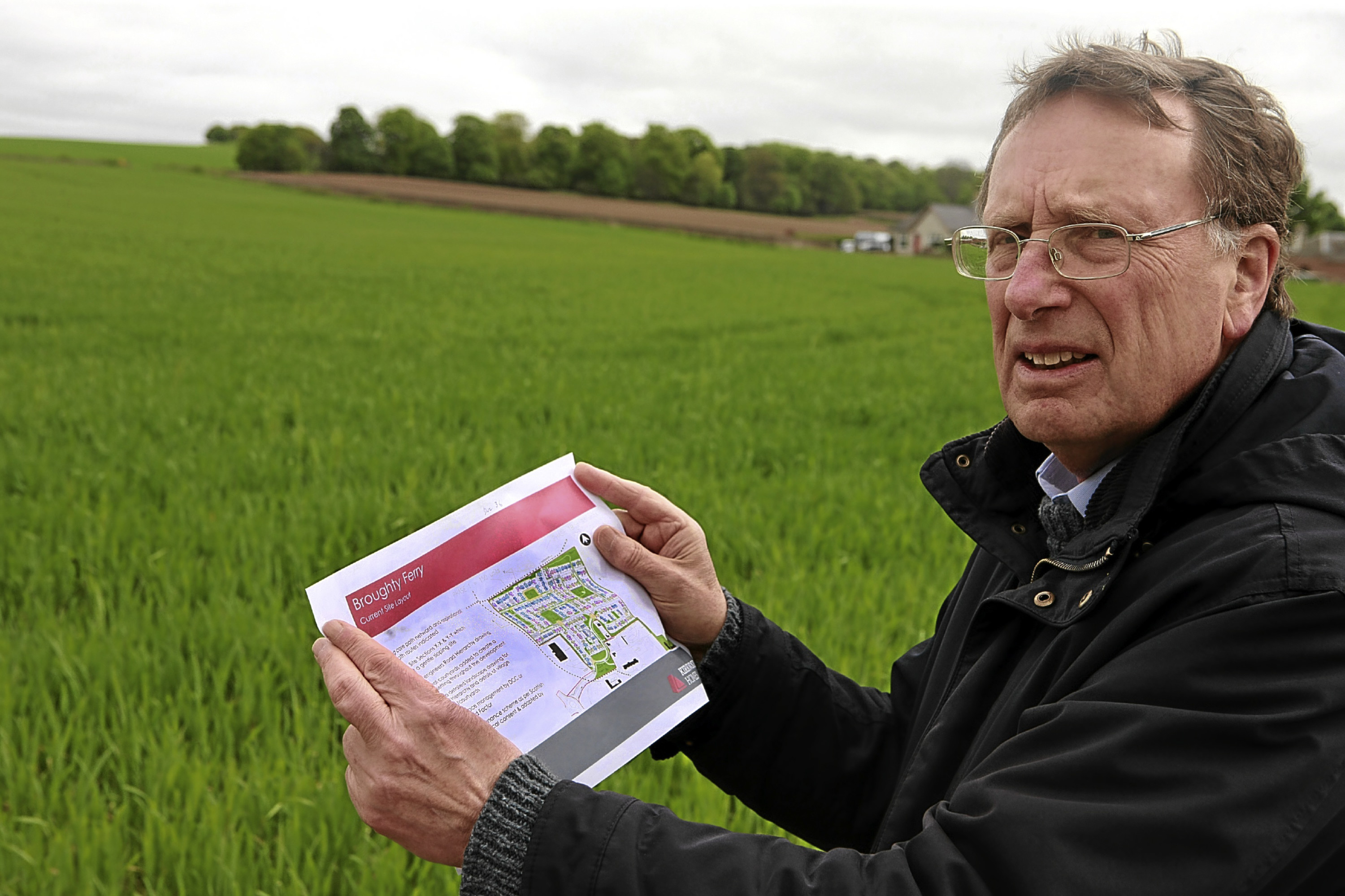 David Hewick, of Broughty Ferry Community Council, at the site with a copy of the development plan.