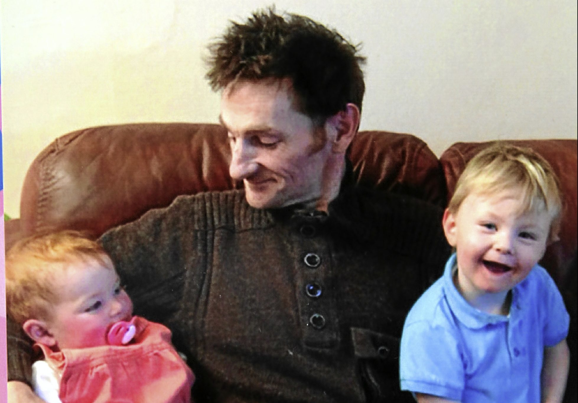 Bruce Candy, who died from cancer after developing stomach pains, with his children Amelia and Oliver.