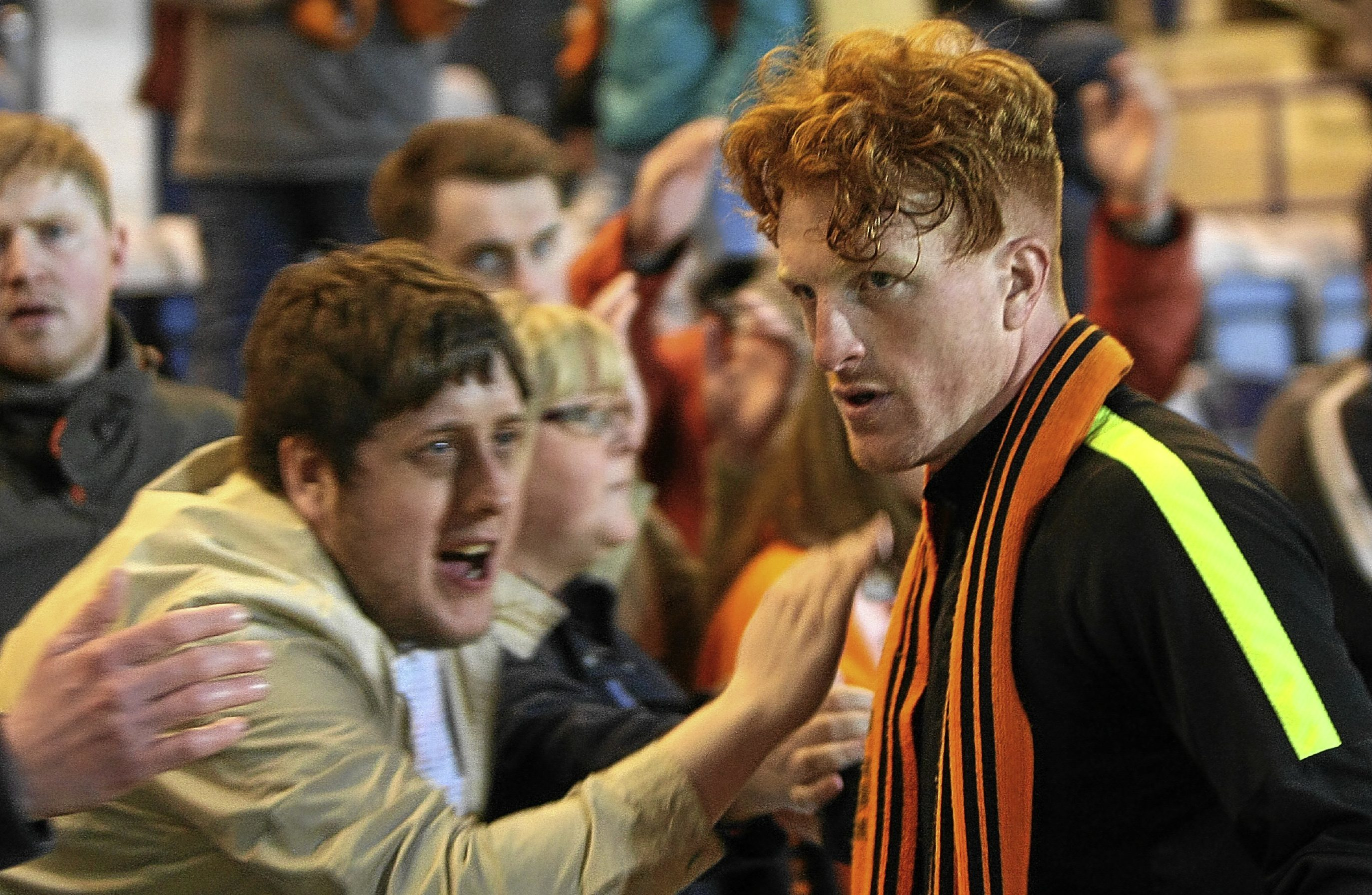 Dundee United supporters commiserate with striker Simon Murray after the derby defeat at Dens consigned the Tangerines to Championship football next season.