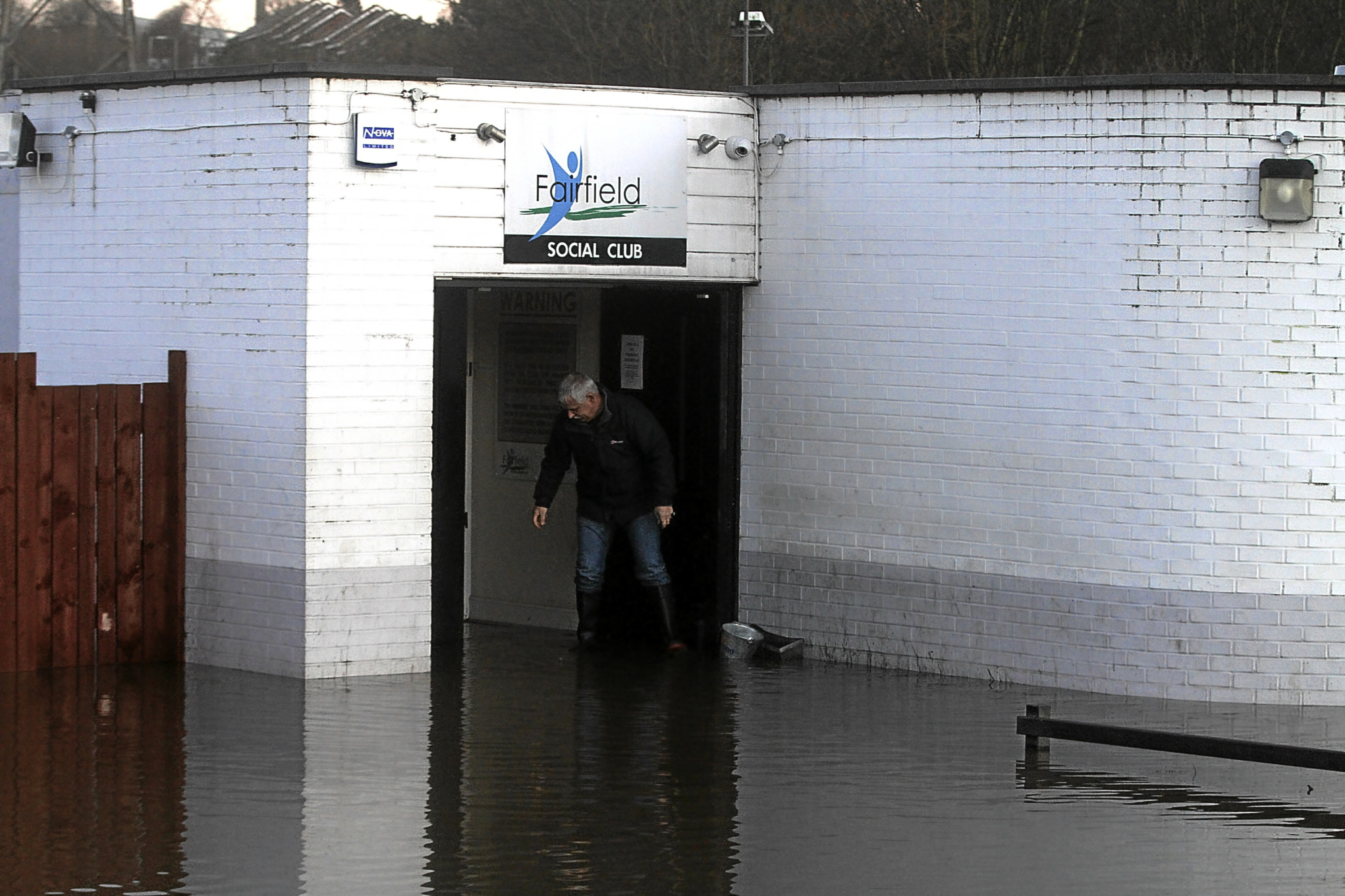 Billy Sorrie, brother of Jim, assesses damage to Fairfield Sports and Social Club. The club may never reopen after getting hit by floods in January.