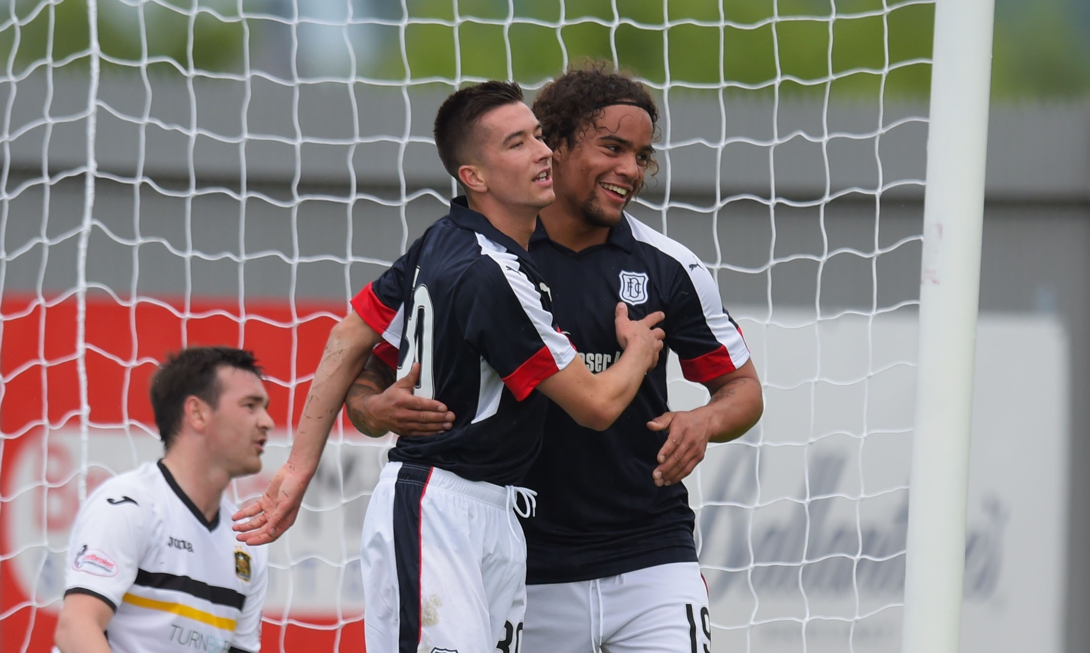 Cammy Kerr is congratulated by Yordi Teijsse after he scoring the opener