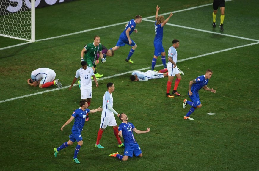 The Iceland players react at full time.
