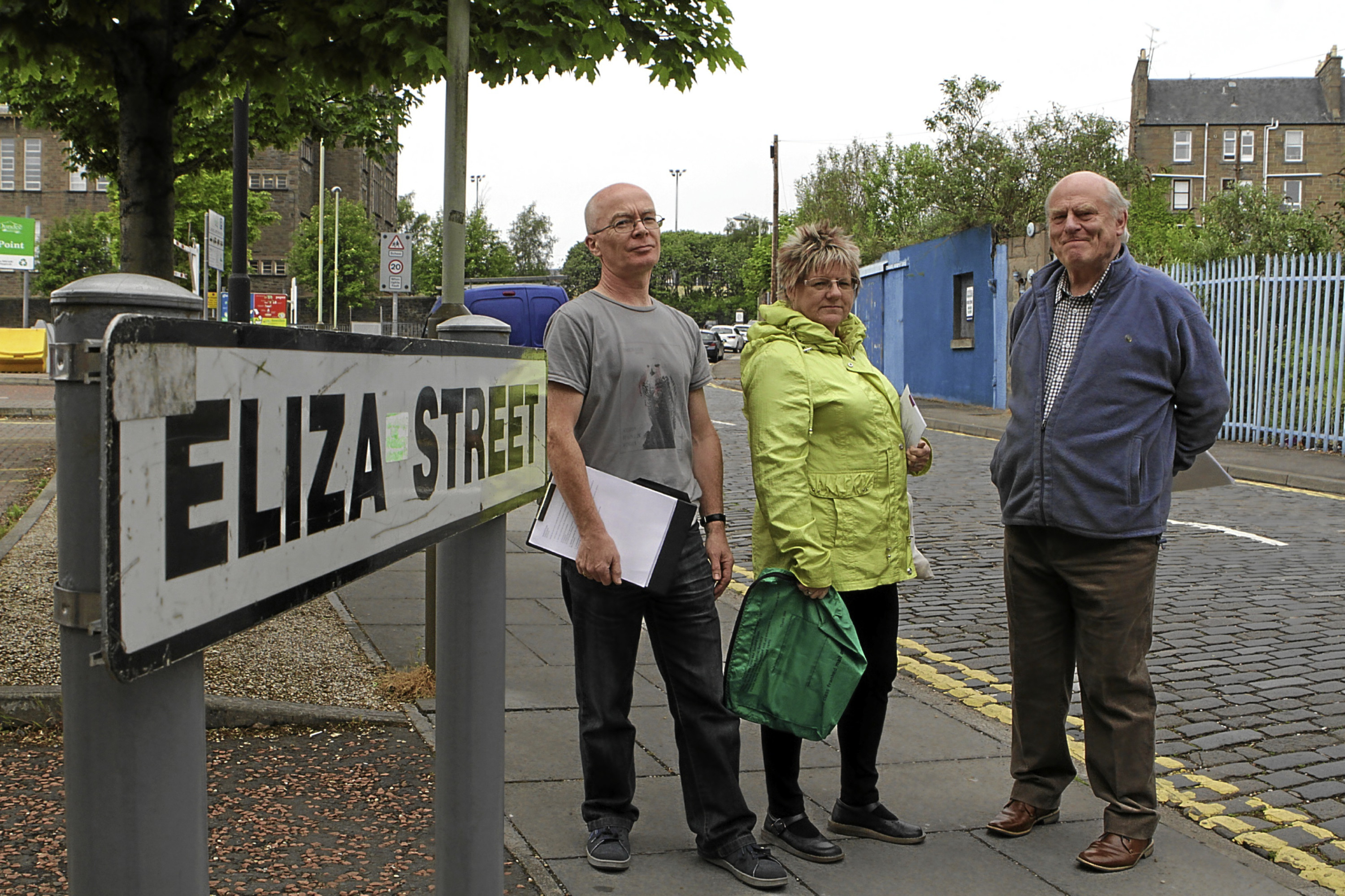 Duncan McCabe, Robbie Fotheringham and David Macdougall of the Stobswell Forum, who are opposed to housing plans on Eliza Street.