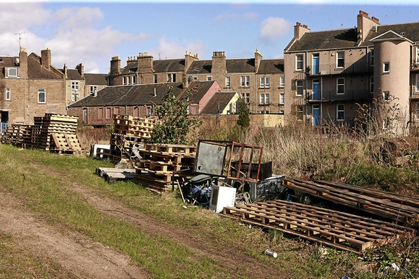 The area of derelict land that is the subject of plans for new homes.