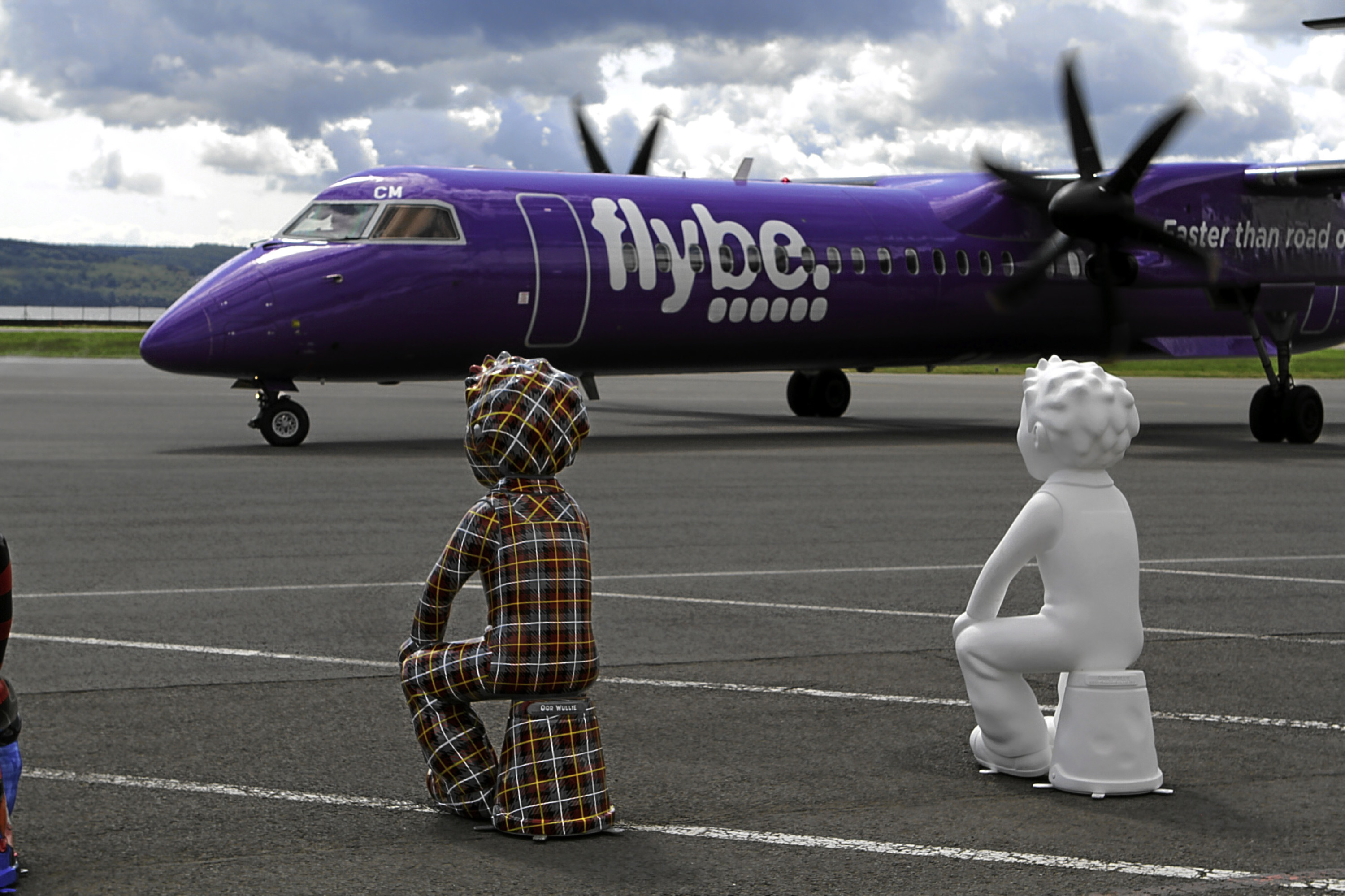 Two Oor Wullie sculptures looked on as the first flight from Amsterdam arrived in Dundee