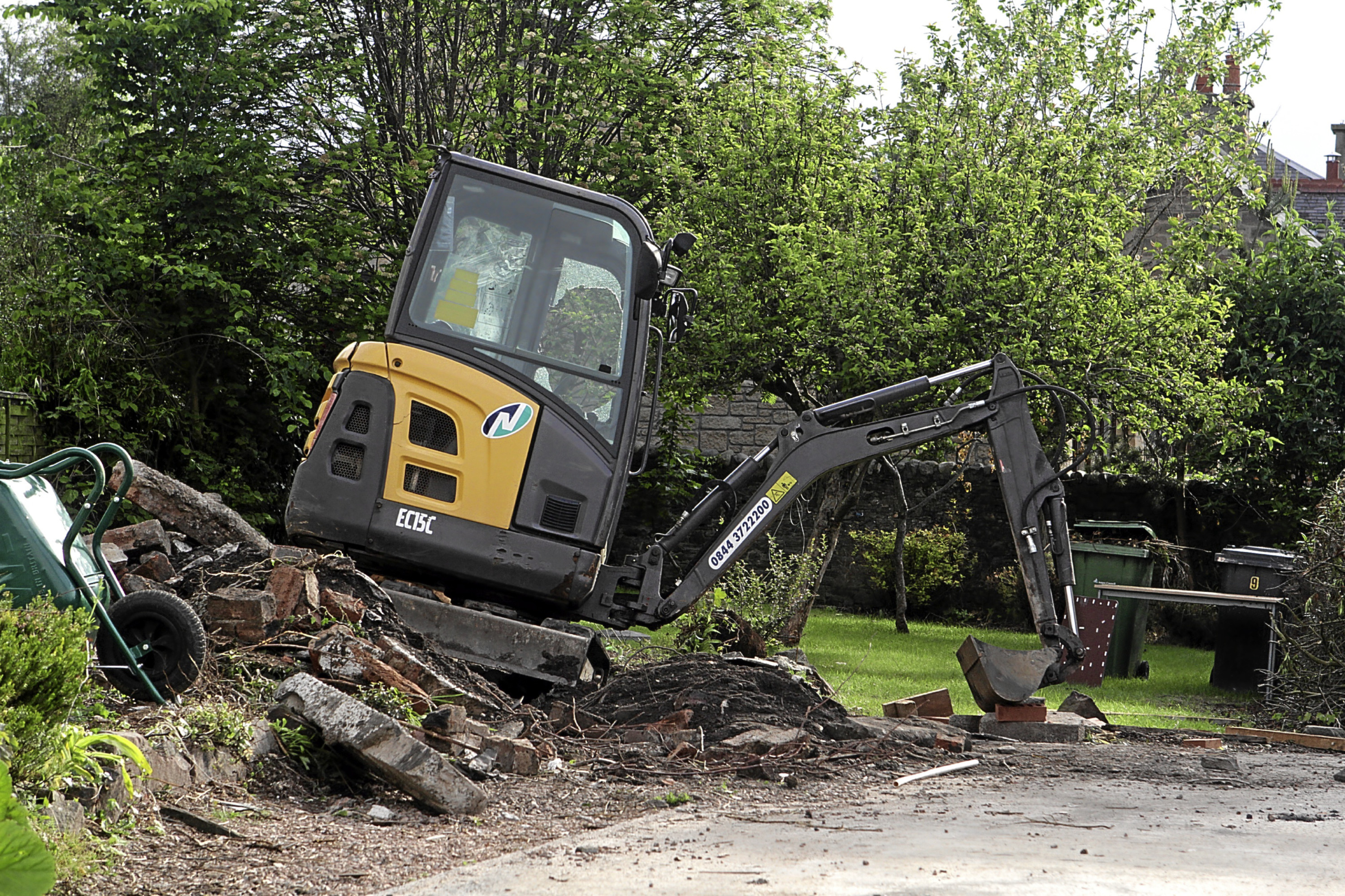 The damaged digger on Green Lane in Carnoustie. A man was taken to hospital after his foot was crushed.