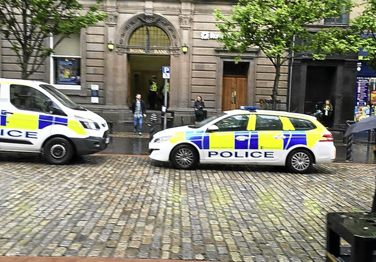 Police at the Royal Bank of Scotland in the city's High Street.