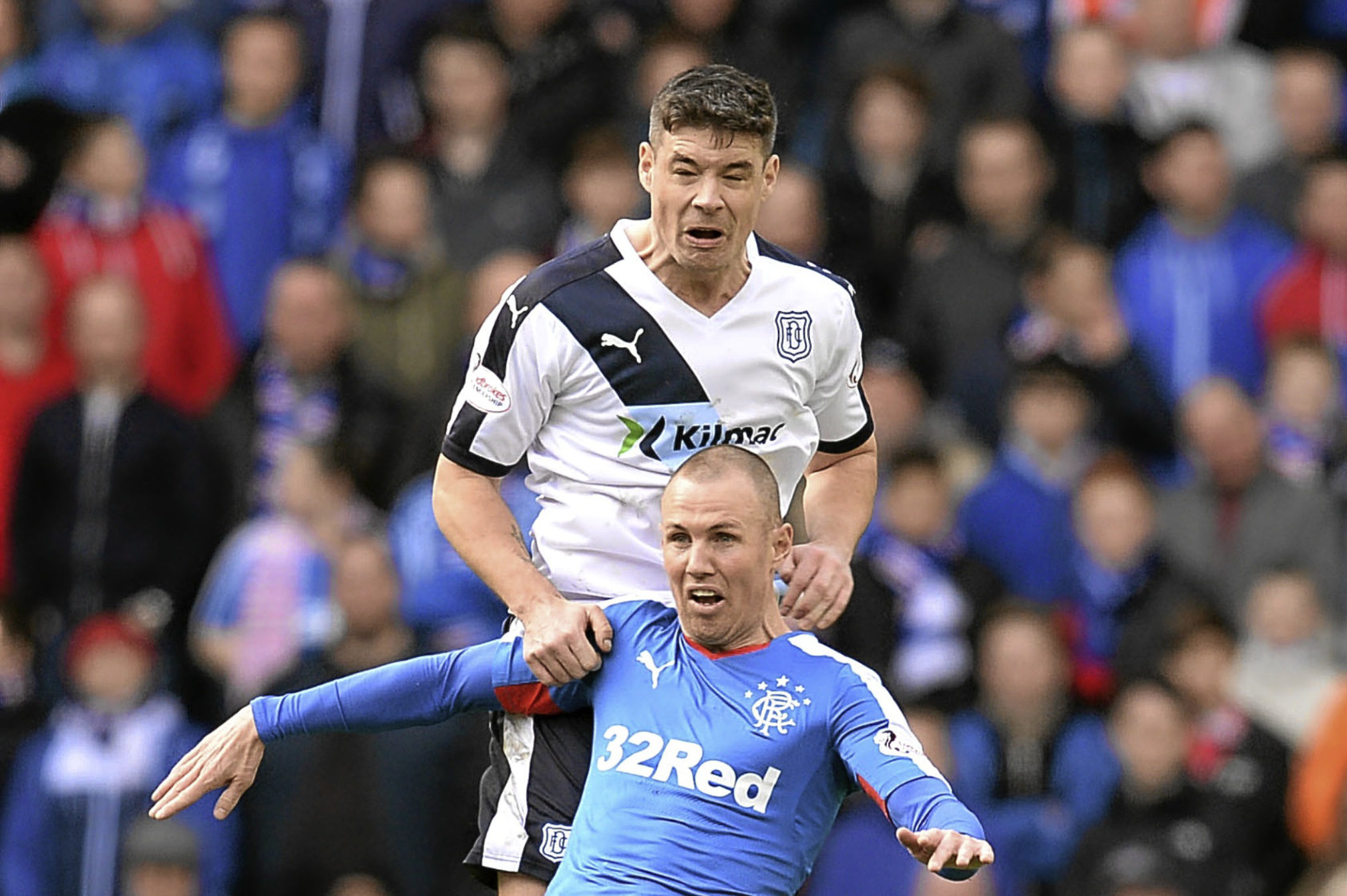Kenny Miller competes with Dundee's Darren O'Dea in the Scottish Cup in 2016
