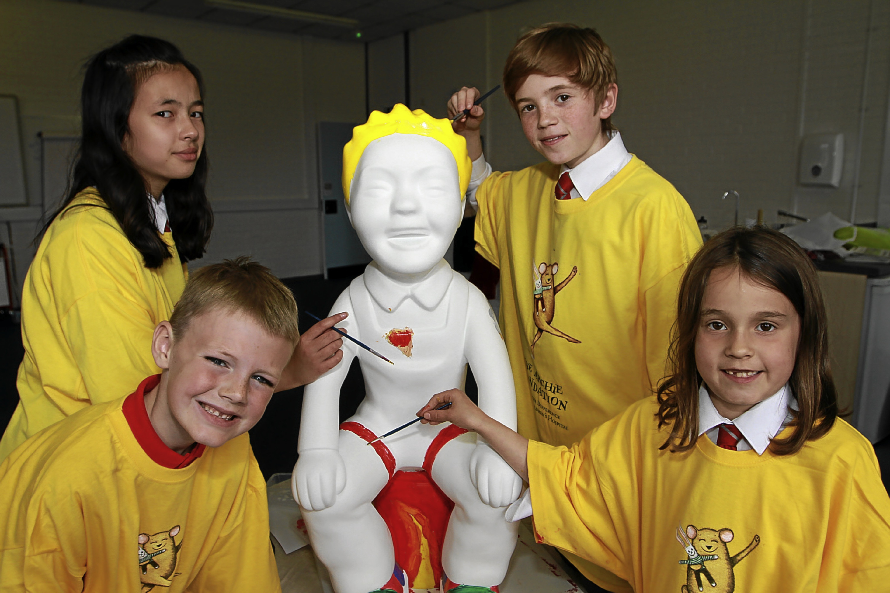 From left, Emily Kelly, 11, Nairn Reynolds, 7, Calum Turpie, 12 and Milly Burns, 7 painting their Oor Wullie sculpture.