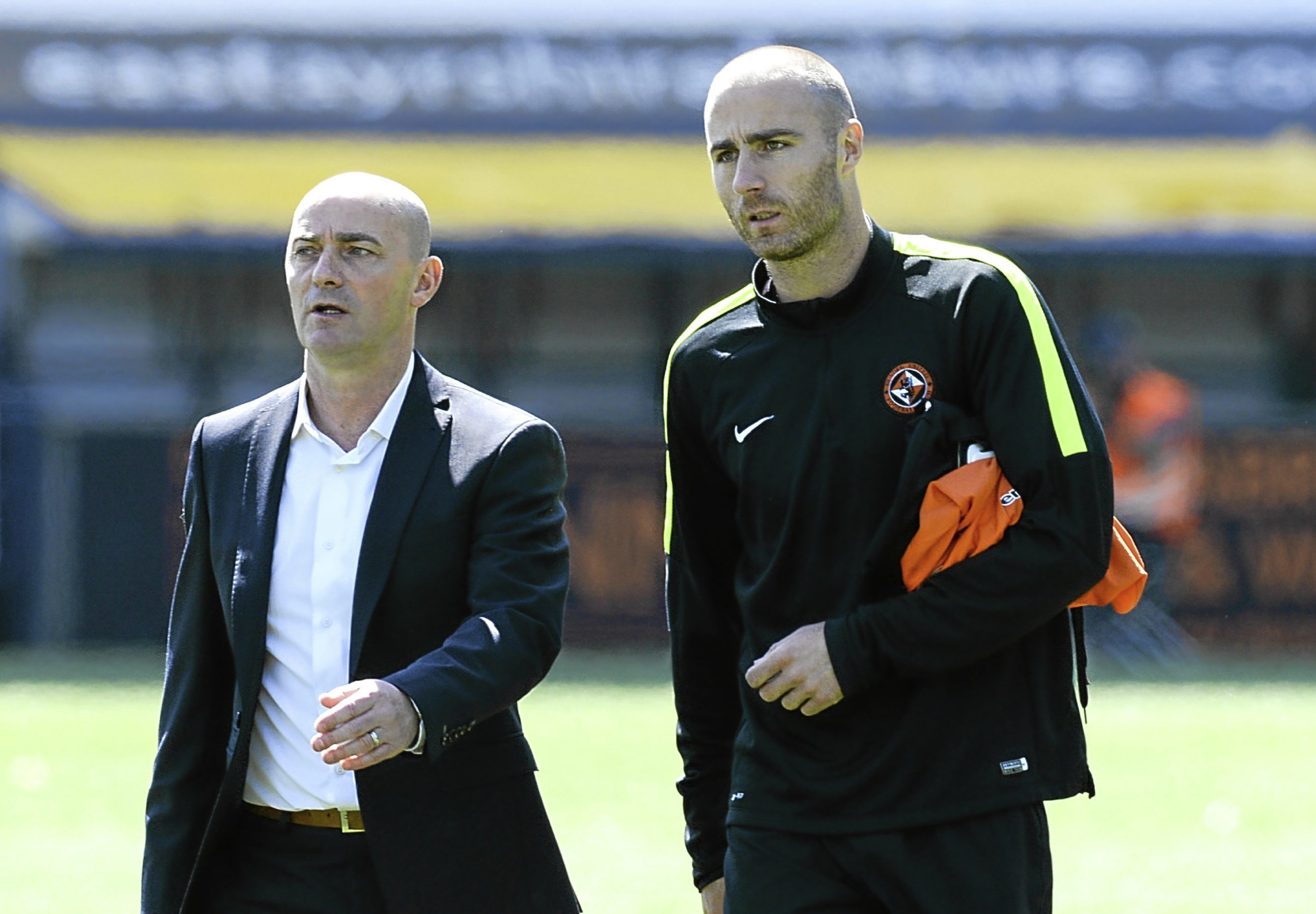 Former Dundee United caretaker manager Gordon Young (left) and Sean Dillon walk off the pitch at full time after a 4-2 win away to Kilmarnock in the final Premiership game of last season.
