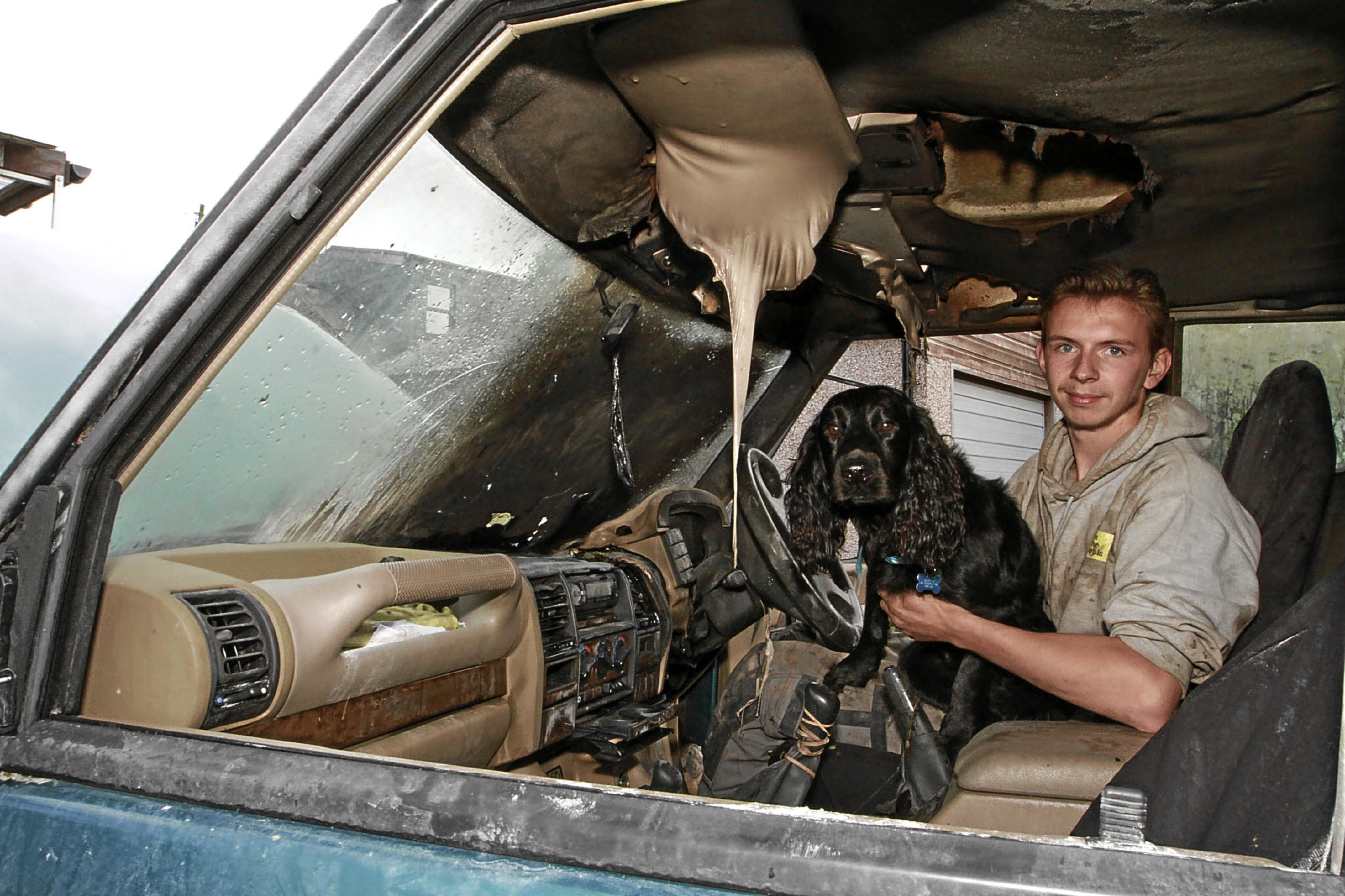 Scott Baxter and his dog Orlo in the burnt out car