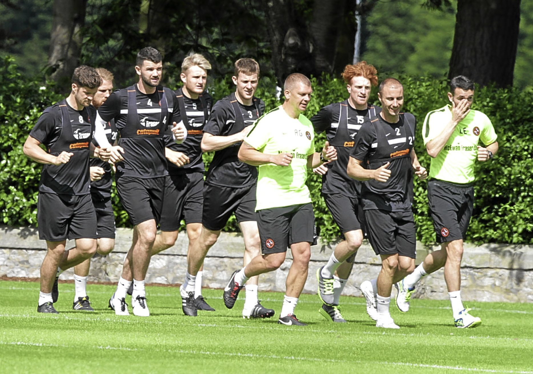 Former Ross County man Stewart Murdoch (far left) joins his Dundee United team-mates for a spot of pre-season exercise at the club's St Andrews training base.