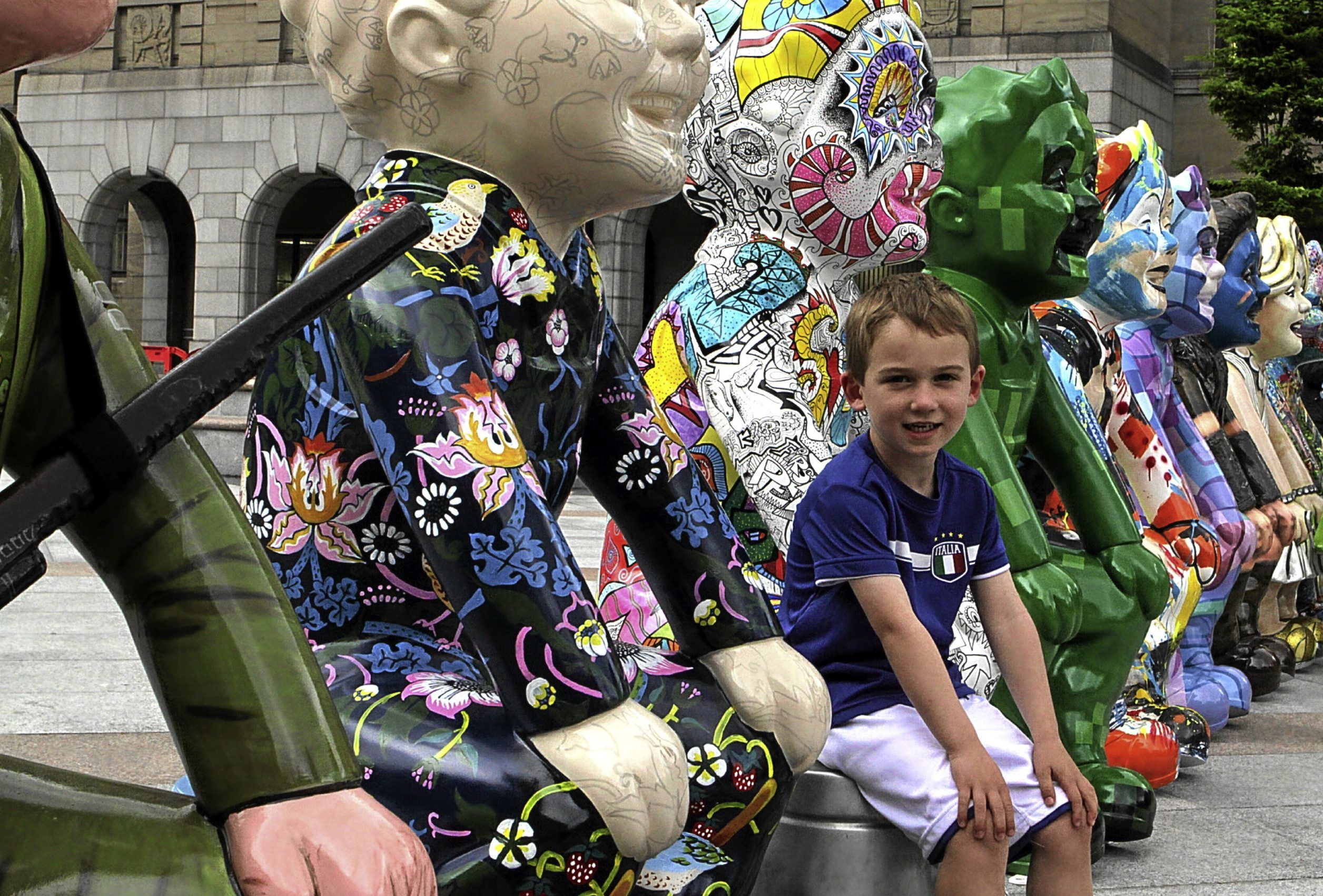 Arran Barnes, four, of Invergowrie, sits between some of the sculptures at the launch in the city square yesterday.