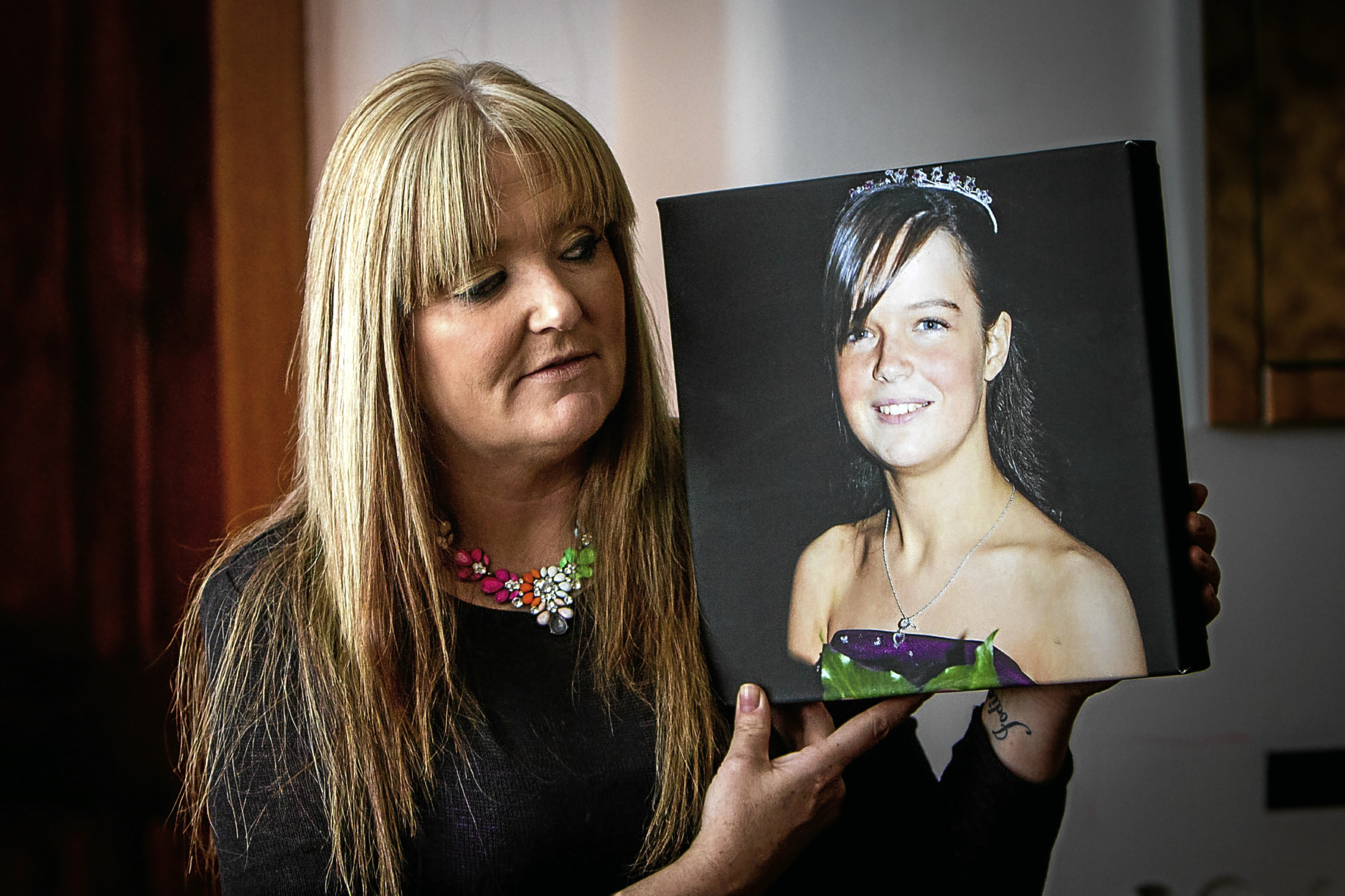 Tracy with a picture of her daughter Jodie