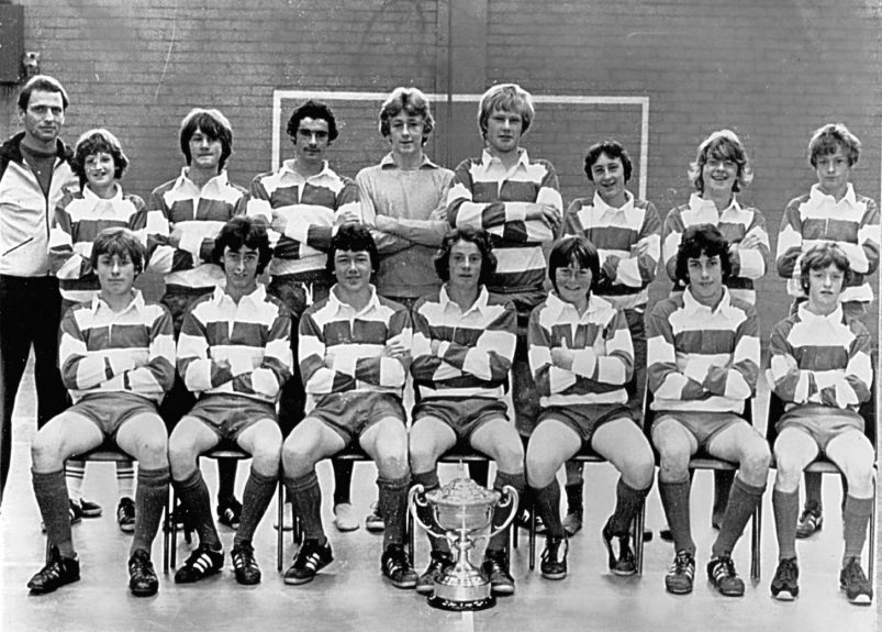 Menzieshill U/15 footballers with the Dundee United Cup in 1978-79. Back row (from left) — Mr Graeme Rodger, E Robertson, T Mitchell, G Walker, I Martin, S McMahon, G Scott, R Stewart, L Cuthill. Front — J Cochrane, G Ritchie, K Thoms, S Kerr, E McAulay, G Caswell, K Docherty.