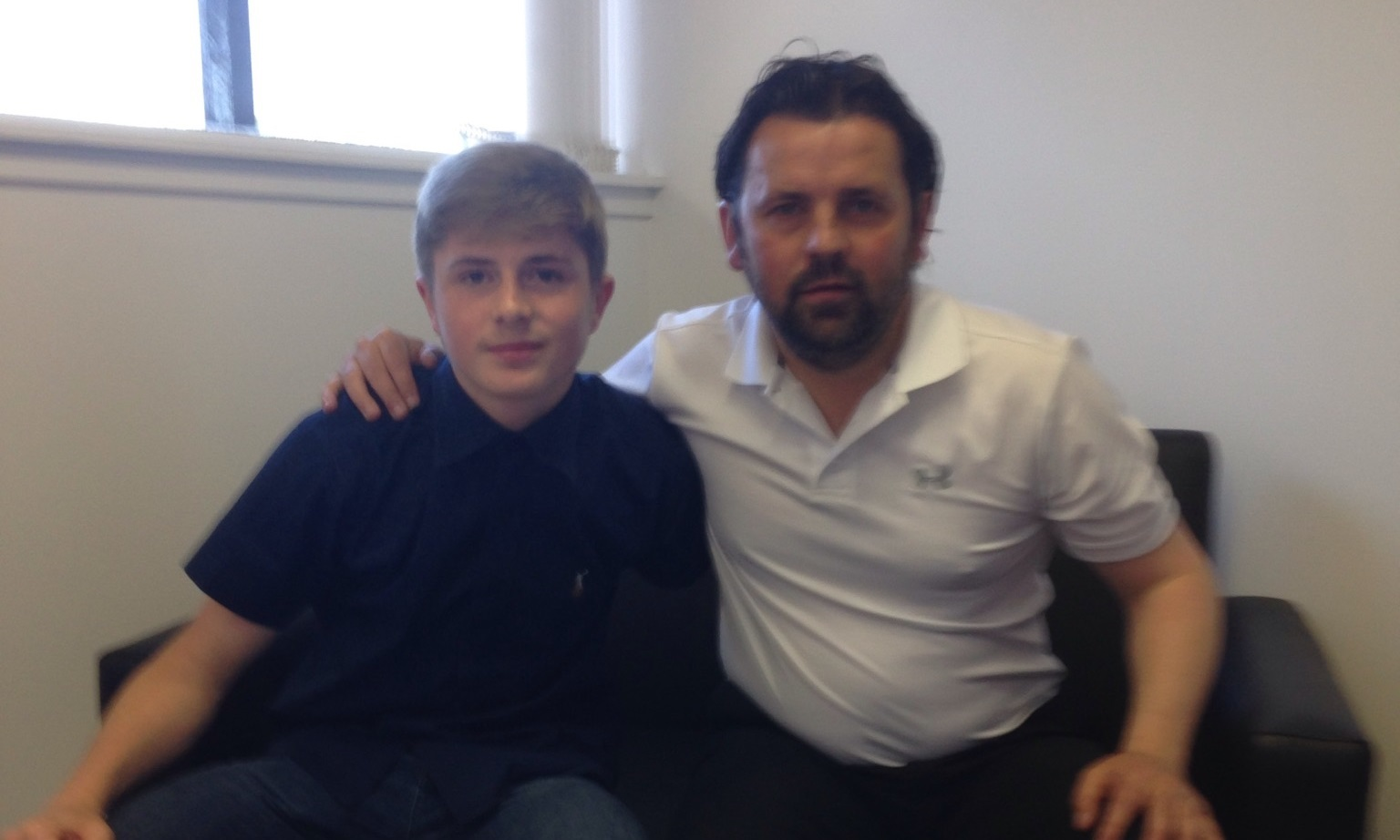 Connor Coupe, who suffers from an eye condition, signs a contract with Dundee FC manager Paul Hartley.