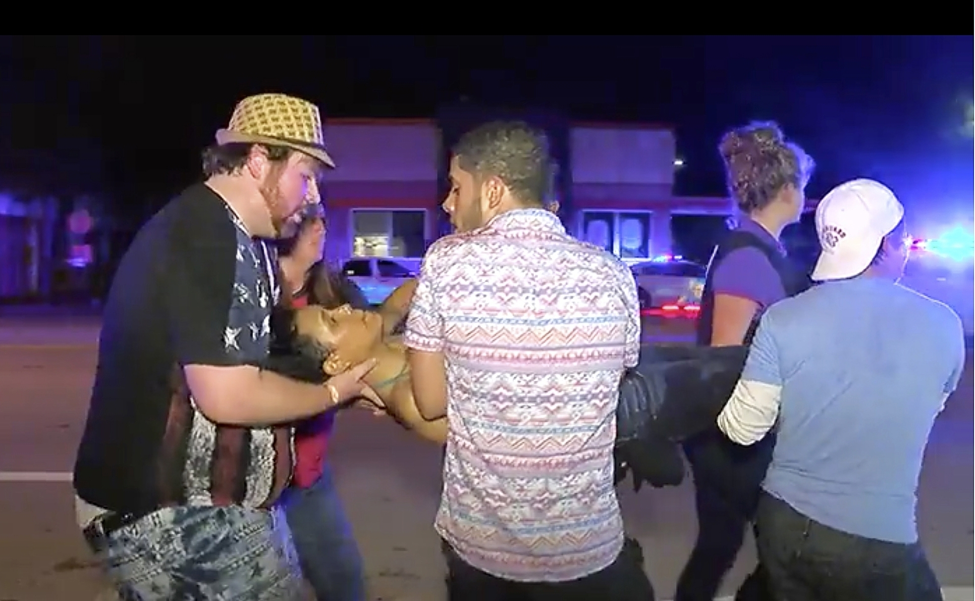 An injured club-goer is carried out following the shooting.