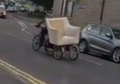 The man, this time in the Polepark area, with an armchair in tow.