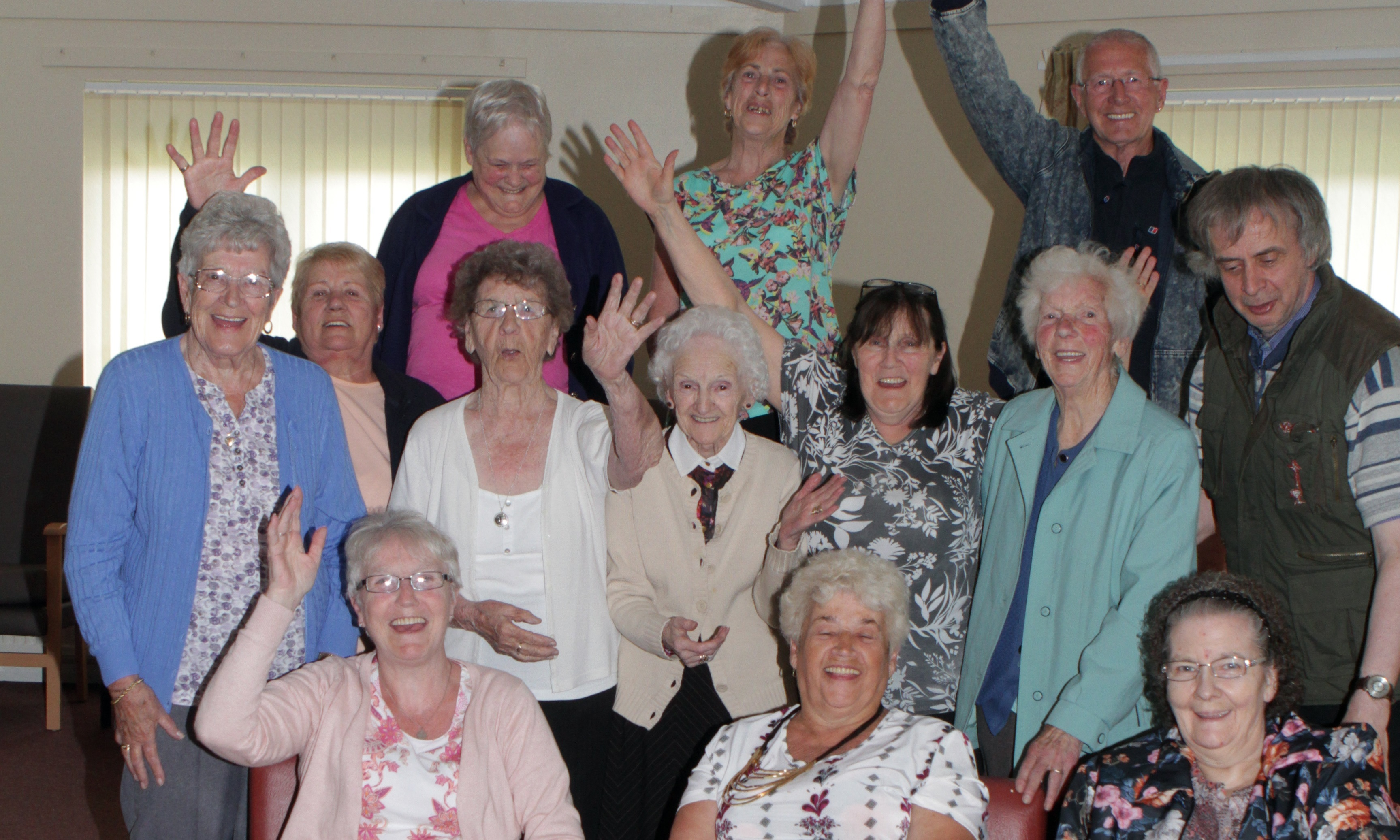 Main picture, folk at Charleston Sheltered housing celebrate the news.
