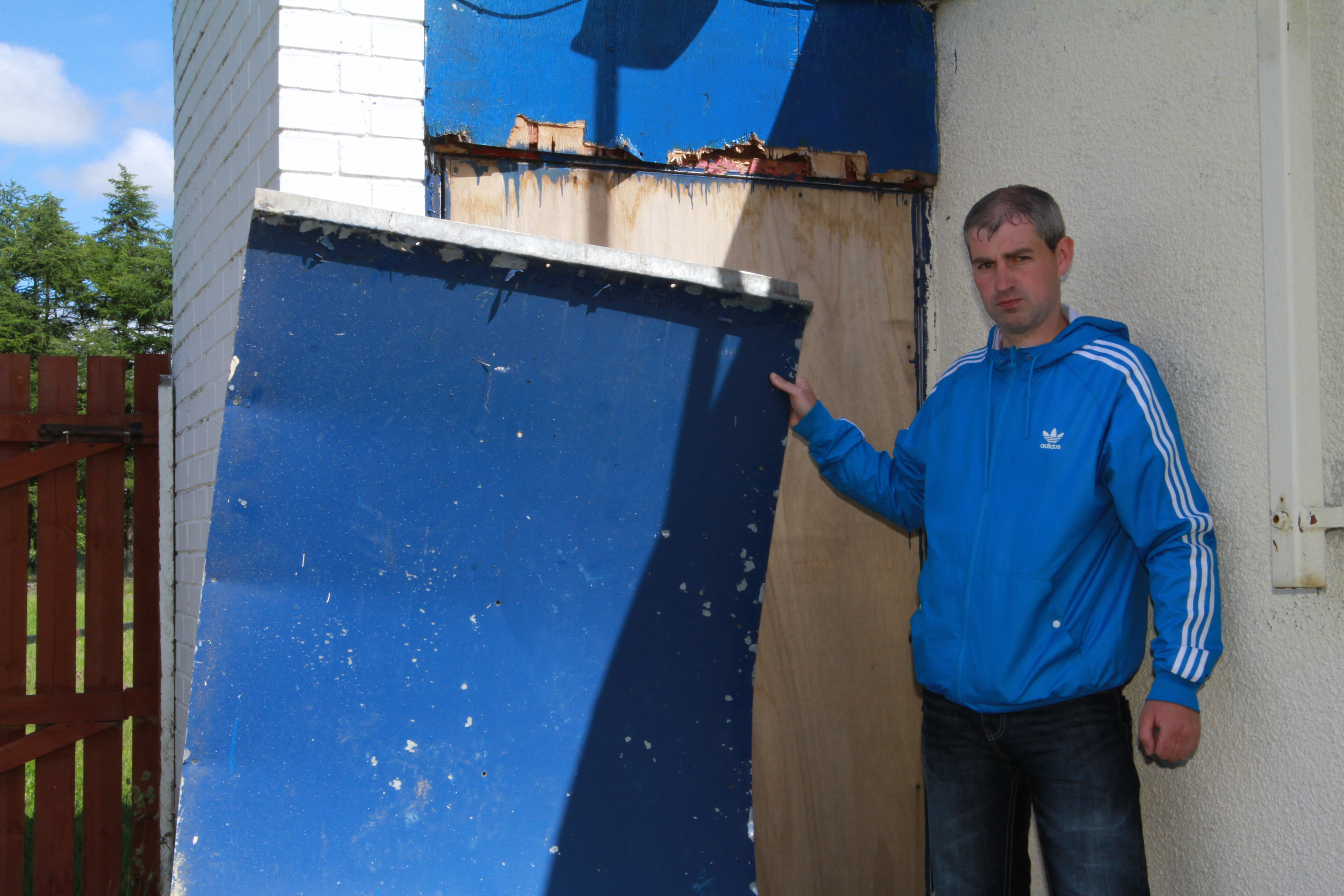 Andy Bell holding the door that was ripped off the clubbie.