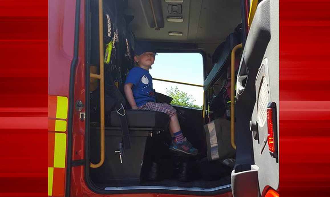 Oscar Drummond gets to sit in a fire engine after helping alert the brigade to a blaze in the woods.