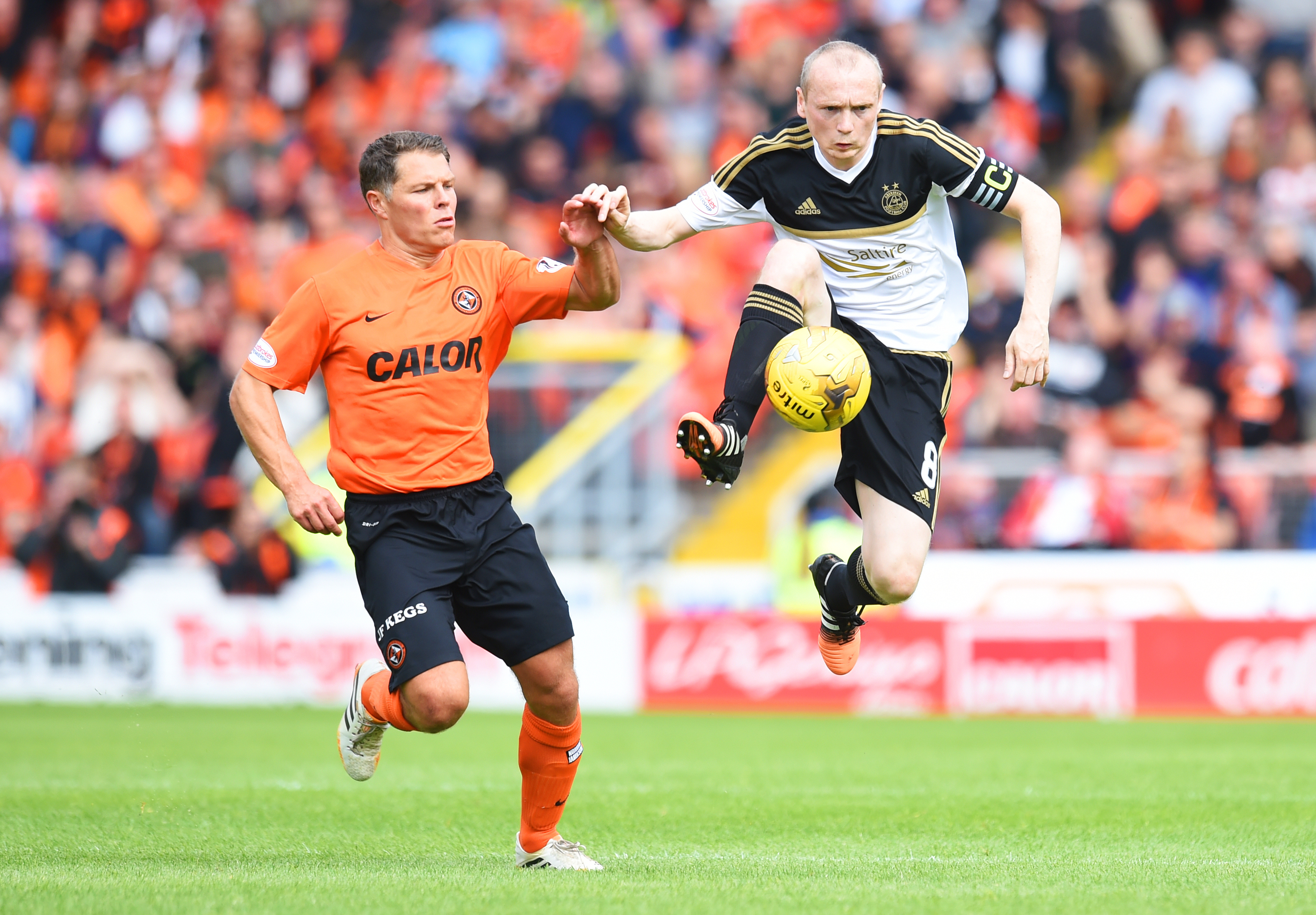 Willo Flood in action for Aberdeen against United. Now he looks set to be back tangerine.