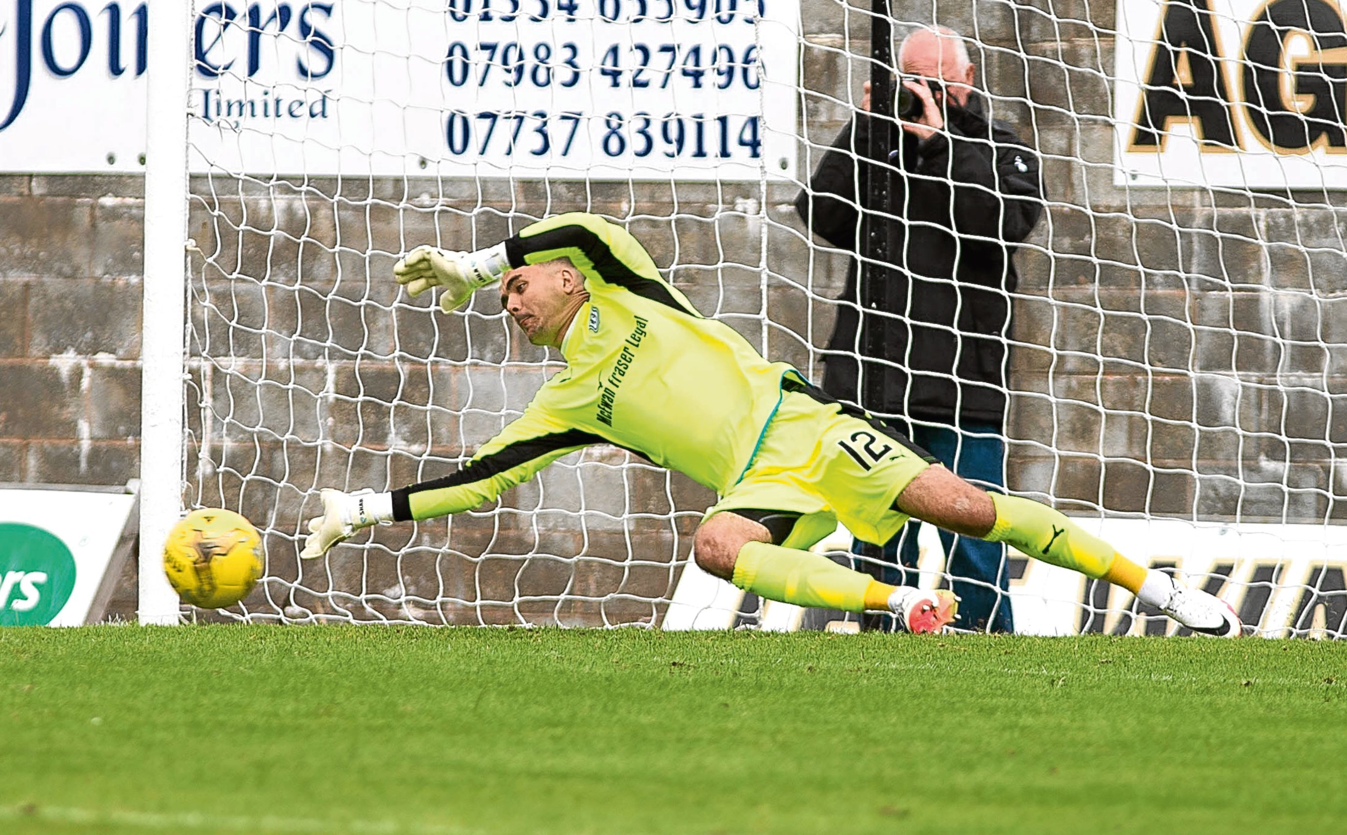 Dundee keeper David Mitchell saves a spot-kick effort from Paul McManus during the Betfred League Cup Group A penalty shoot-out at Bayview. Picture by David Young