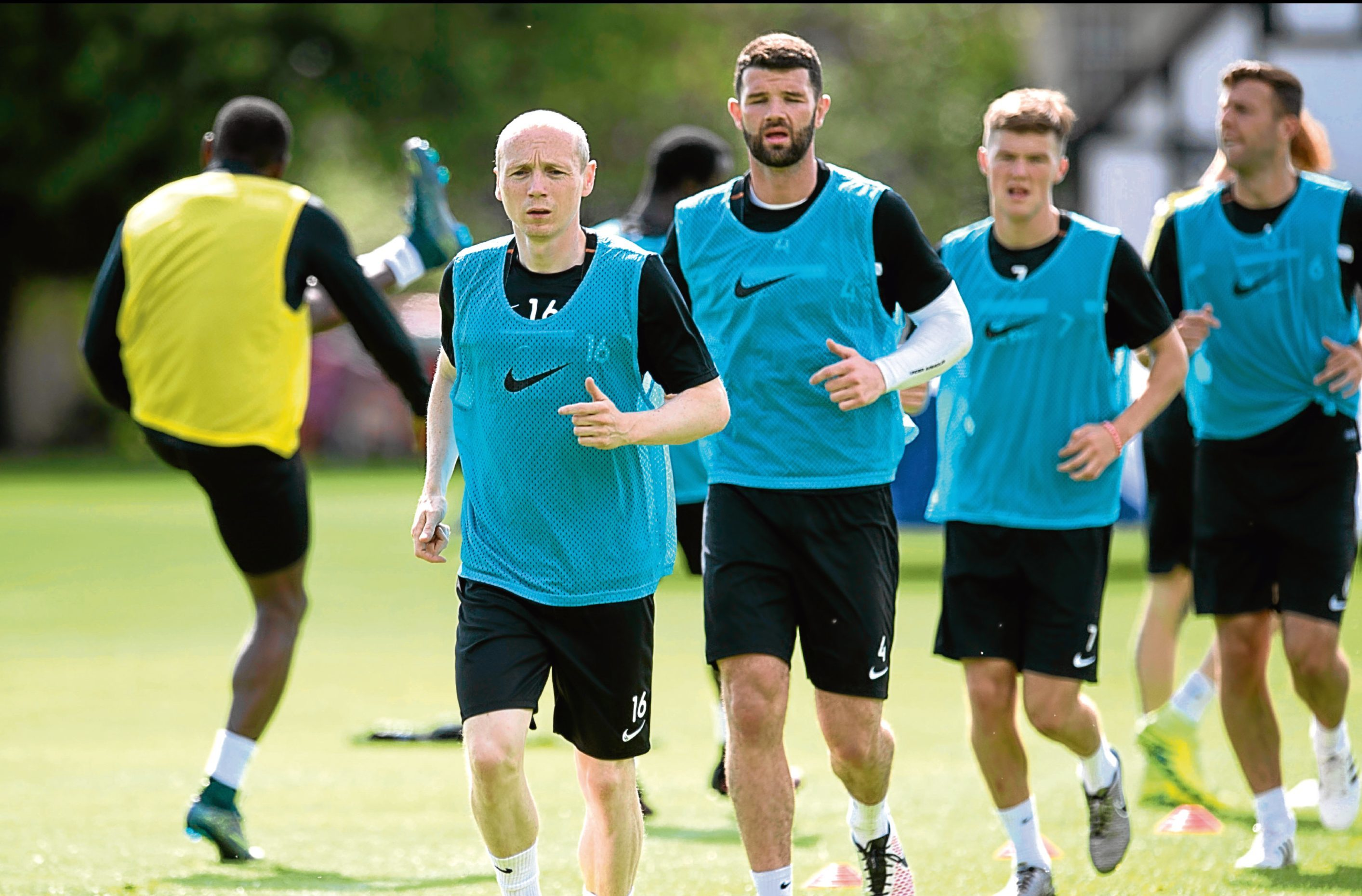 Willo Flood gets in some training at St Andrews alongside his new colleagues.