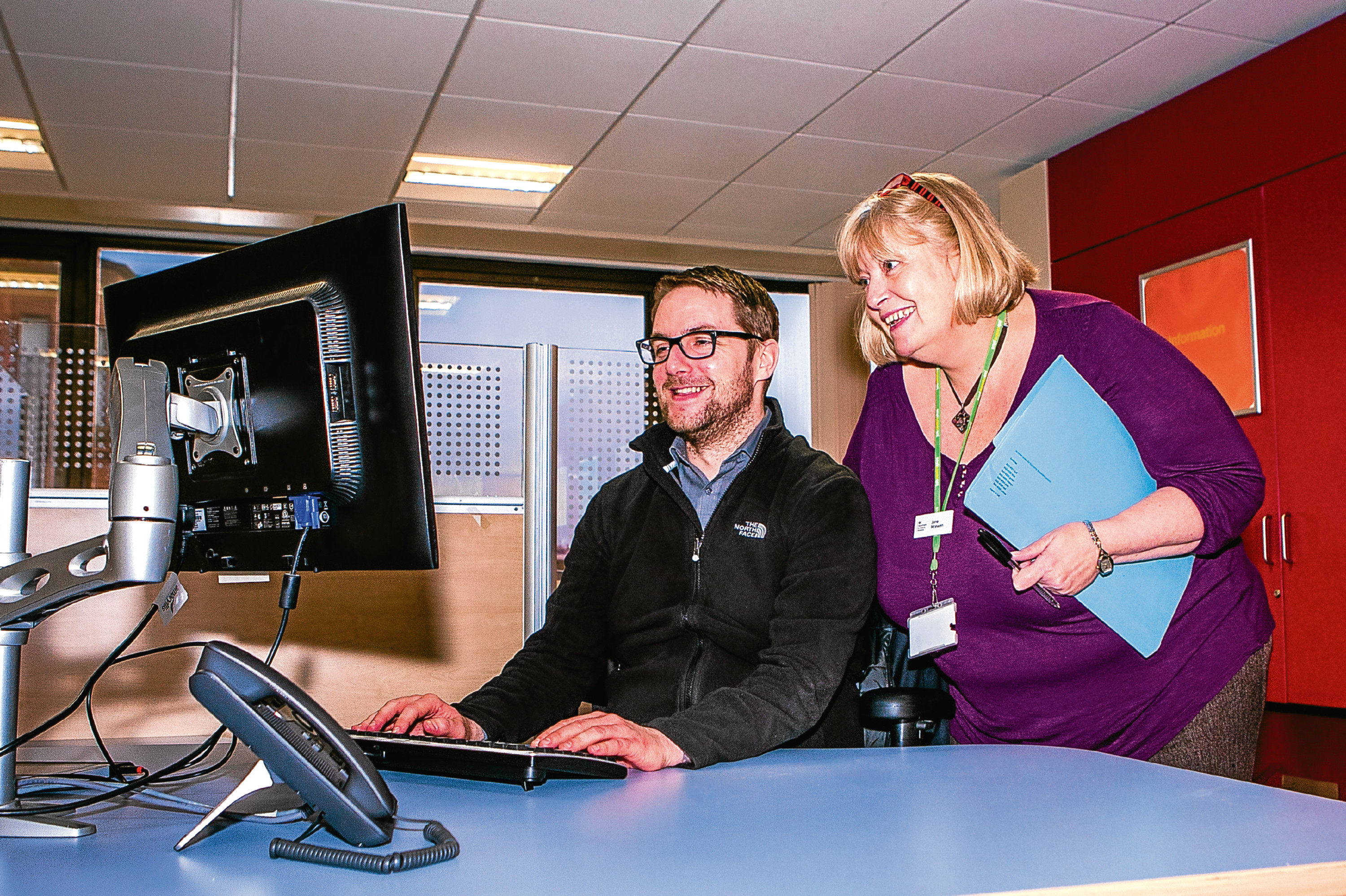 Jobcentre worker Steven Barclay with Jane McEwen