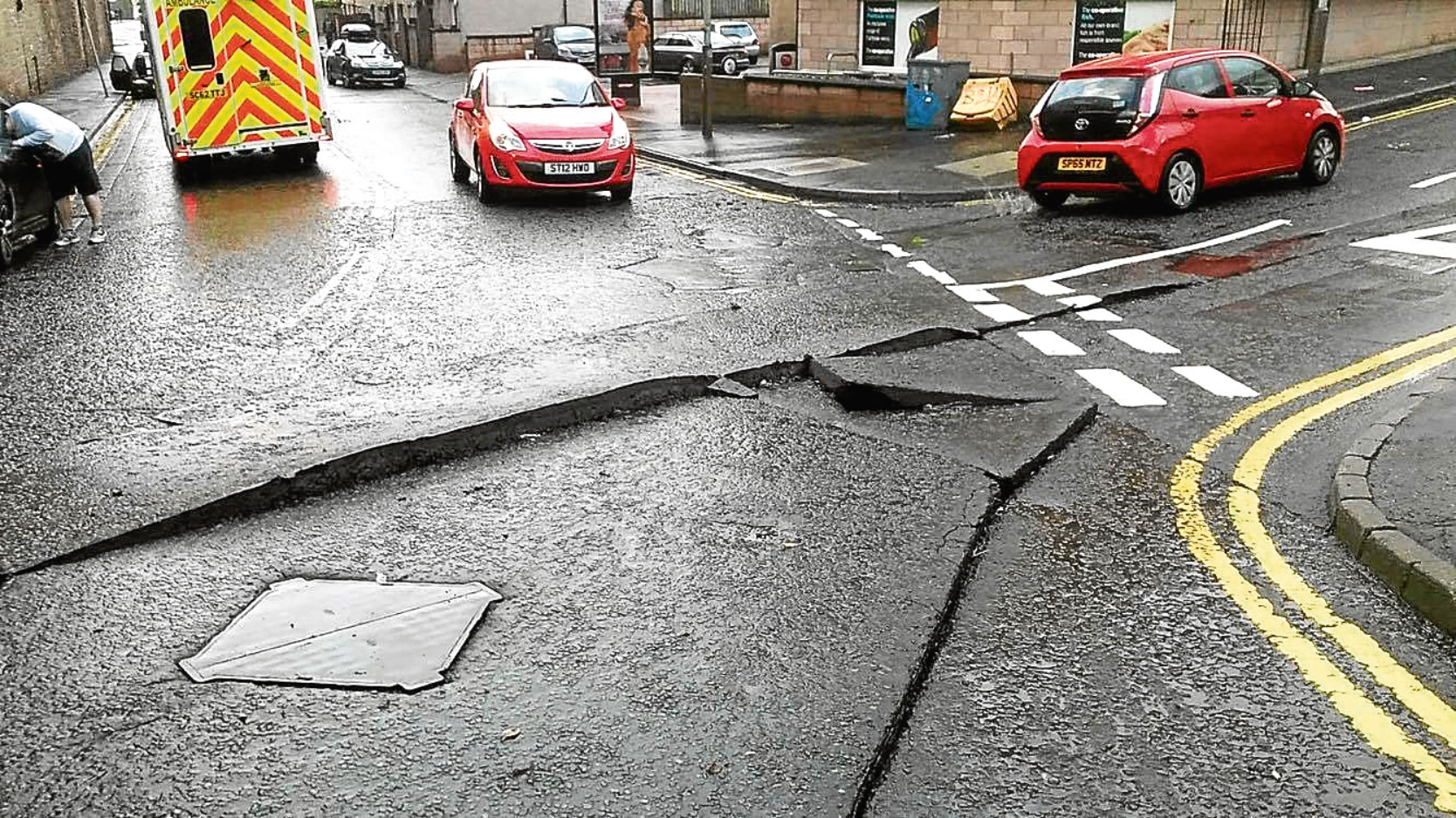 The road surface at the junction of Polepark Road and Edward Street was destroyed after a heavy storm.
