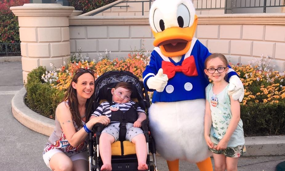 Blake and family with Donald Duck at Disneyland Paris.