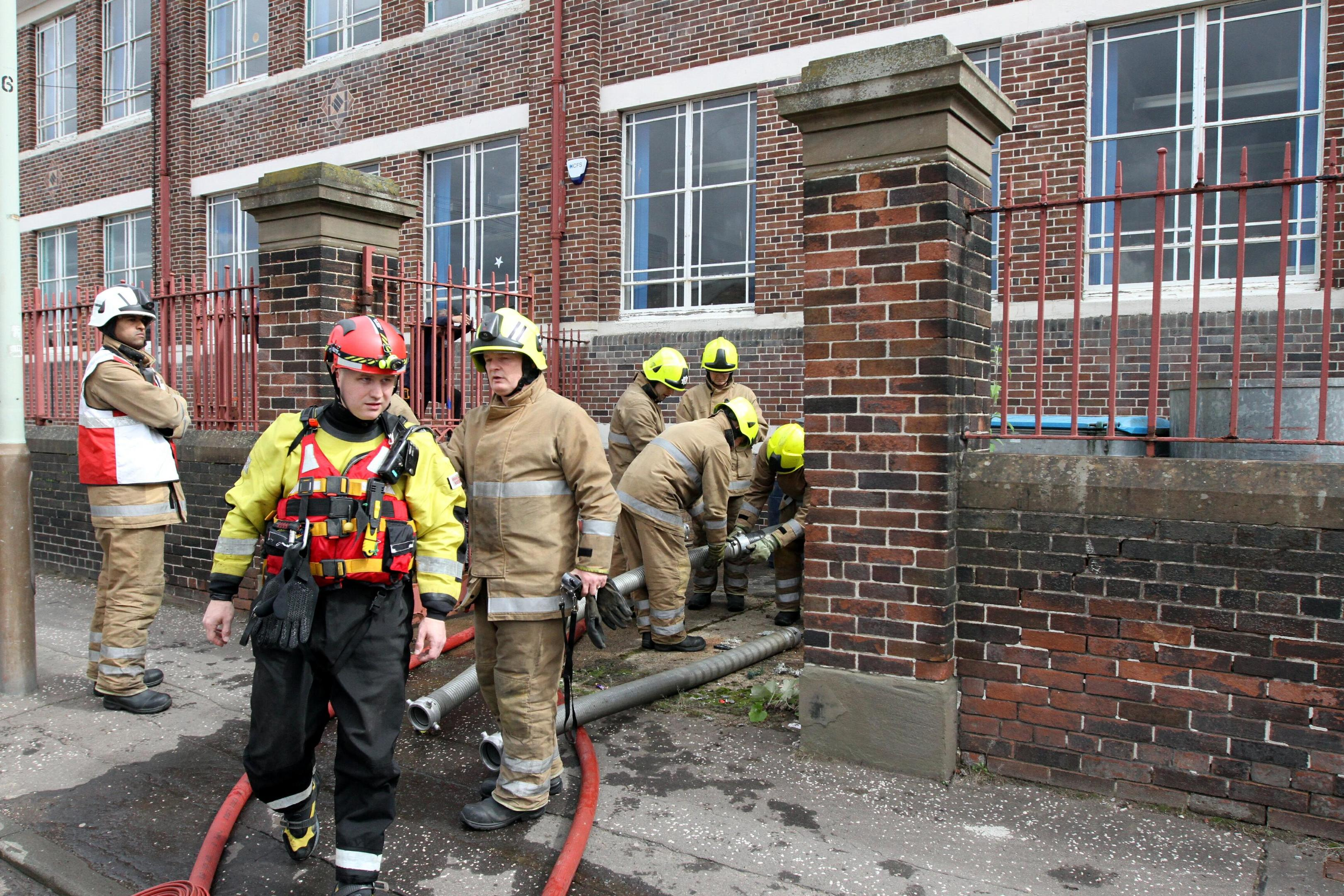 Firefighters at the old St Joseph's Primary School building on Bellfield Street.