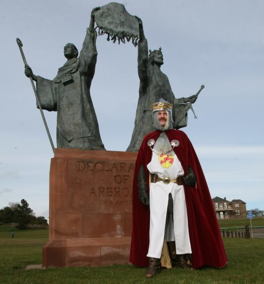 The Declaration of Arbroath statue at the entrance to the Angus town